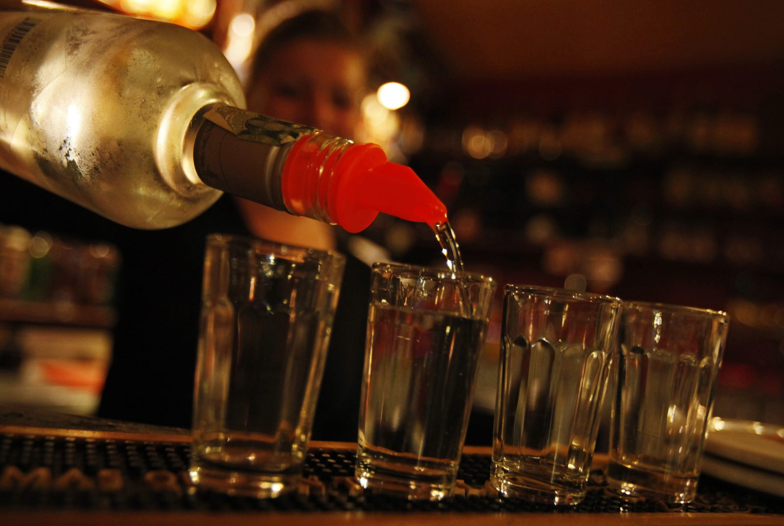 A bartender serves alcohol at a bar in Prague September 12, 2012. Fourteen people have died in the Czech Republic and at least 20 are in hospital after drinking bootleg vodka and rum containing methanol, police said on Wednesday, in the worst case of fatal alcohol poisoning in the country in at least 30 years.