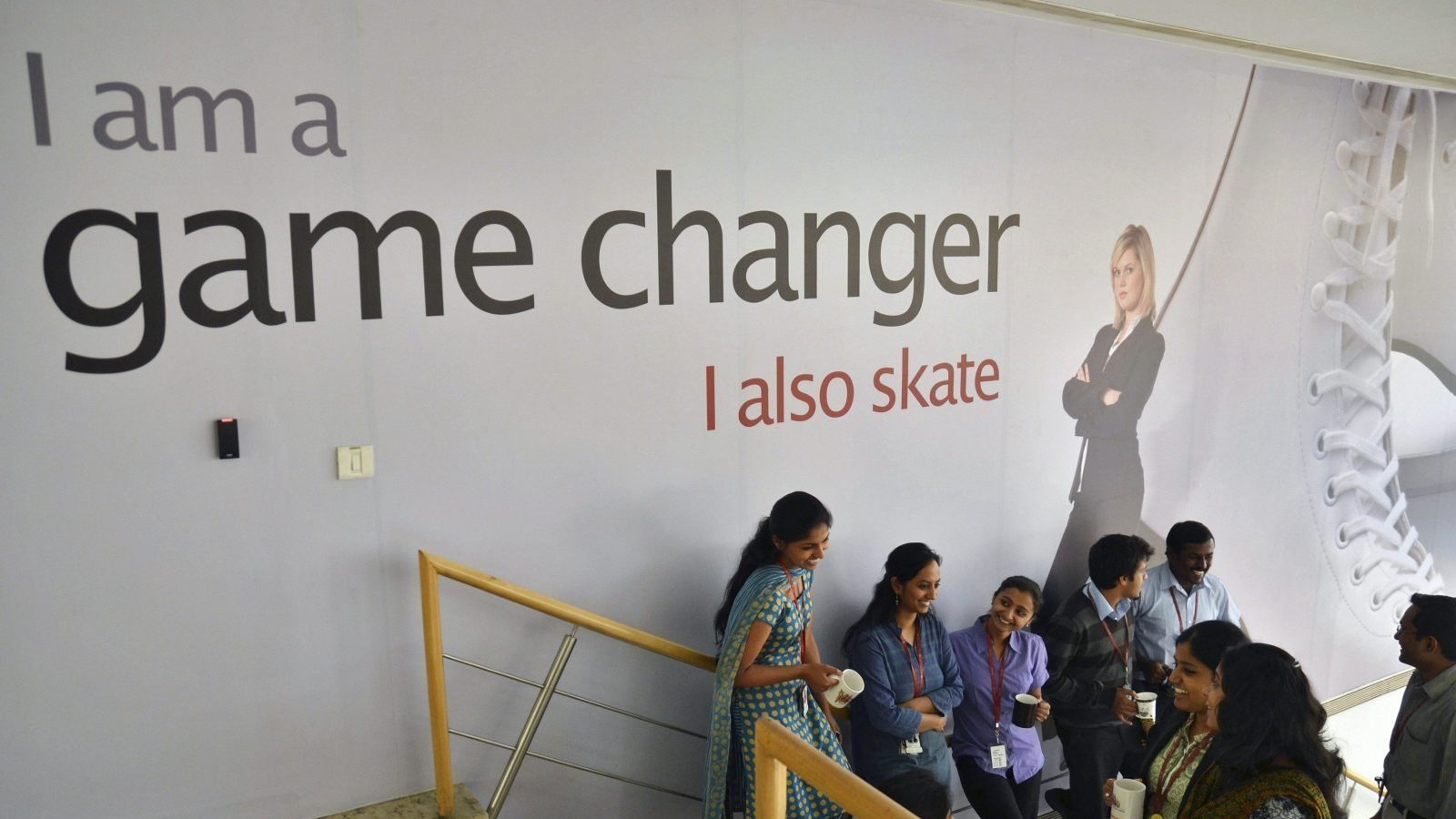 Employees chat with each other during lunch hours at the Indian headquarters of iGate in the southern Indian city of Bangalore February 4, 2013. A former Infosys Ltd executive is challenging the IT outsourcing industry's billing model by charging for results instead of basing fees on the time and labour put in by the armies of staff working for India's big firms. Picture taken February 4, 2013. REUTERS/Stringer (INDIA - Tags: BUSINESS SCIENCE TECHNOLOGY) - RTR3E3E6