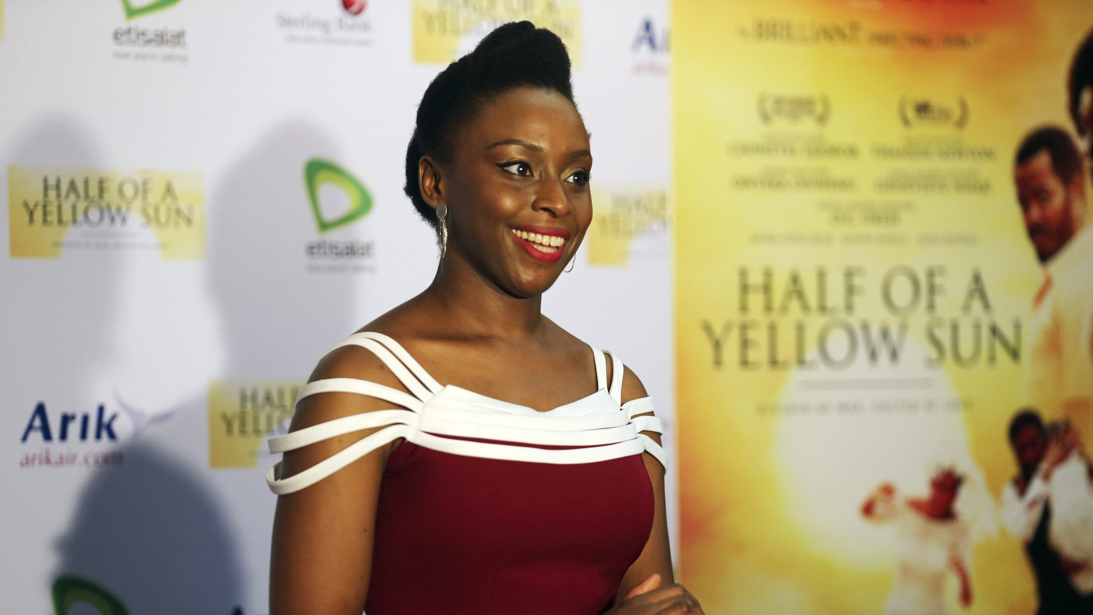 "Nigerian novelist Chimamanda Ngozi Adichie arrives for the premier of film ""Half of a Yellow Sun"", an adaptation of her book, in Lagos April 12, 2014."