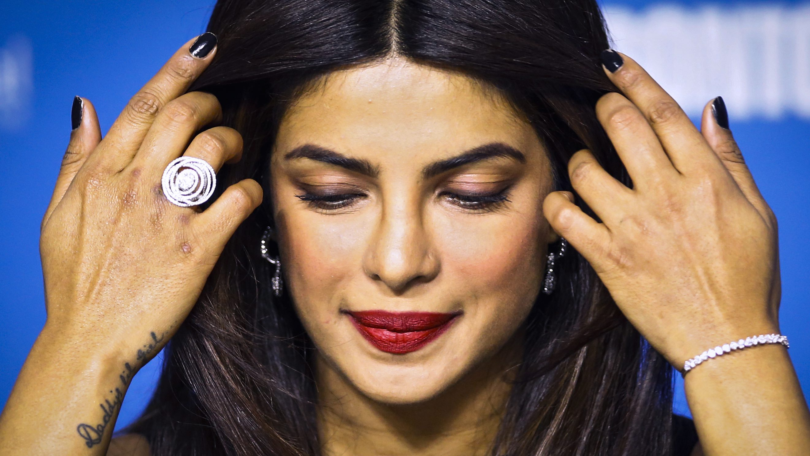 "Chopra of India plays adjusts her hair during the news conference for ""Mary Kom"" at the Toronto International Film Festival in Toronto"