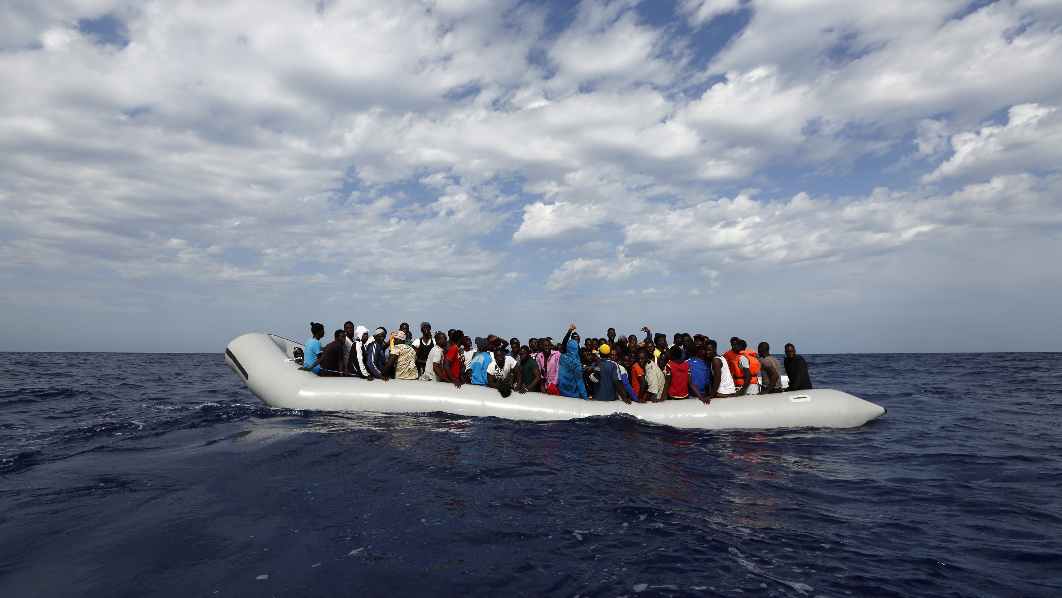 Handout photo shows 104 sub-Saharan Africans on board a rubber dinghy waiting to be rescued by the NGO Migrant Offshore Aid Station some 25 miles off the Libyan coast