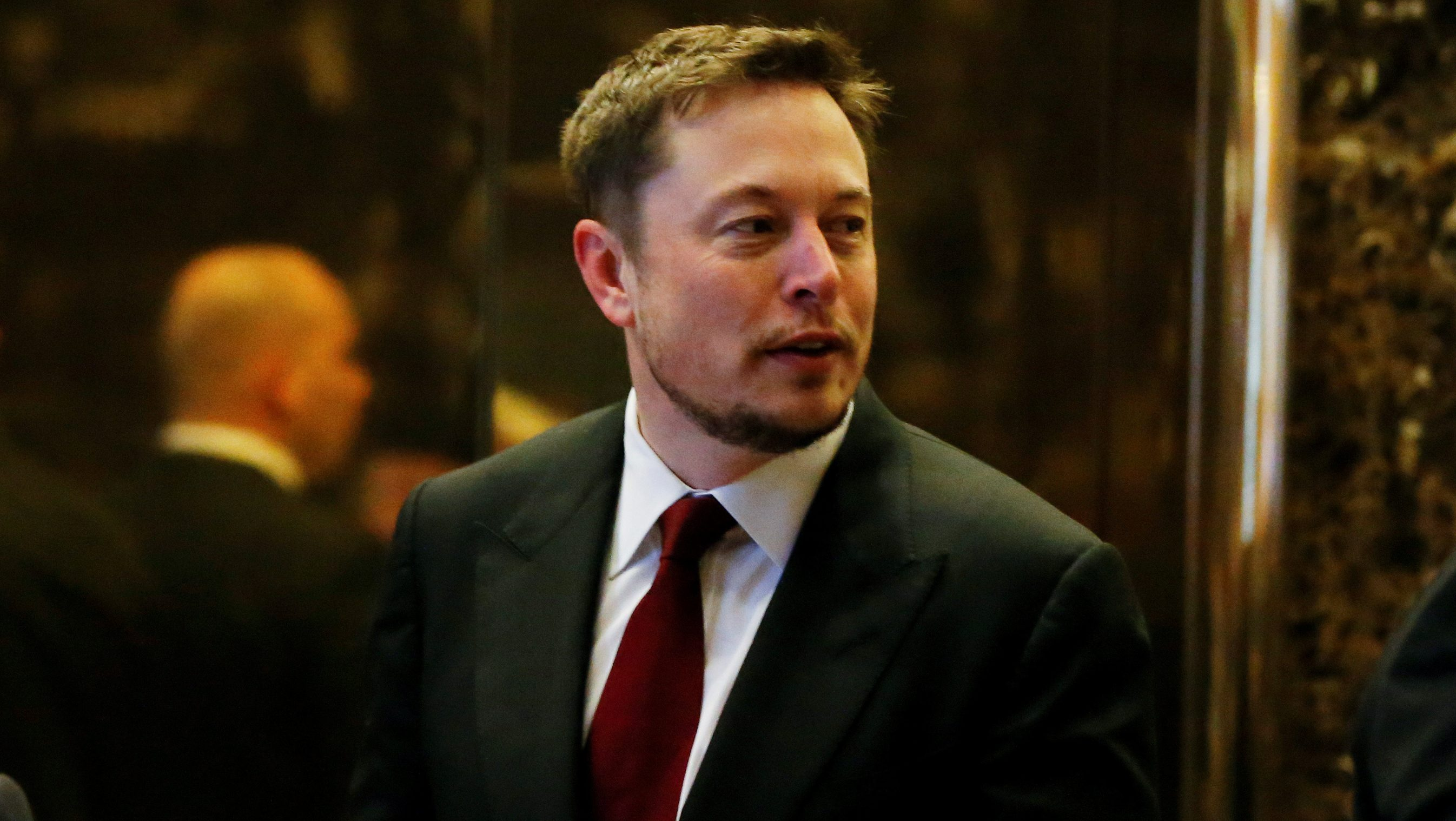 FILE PHOTO: Tesla Chief Executive, Elon Musk enters the lobby of Trump Tower in Manhattan, New York, U.S., January 6, 2017. REUTERS/Shannon Stapleton/File Photo - RTS128V1
