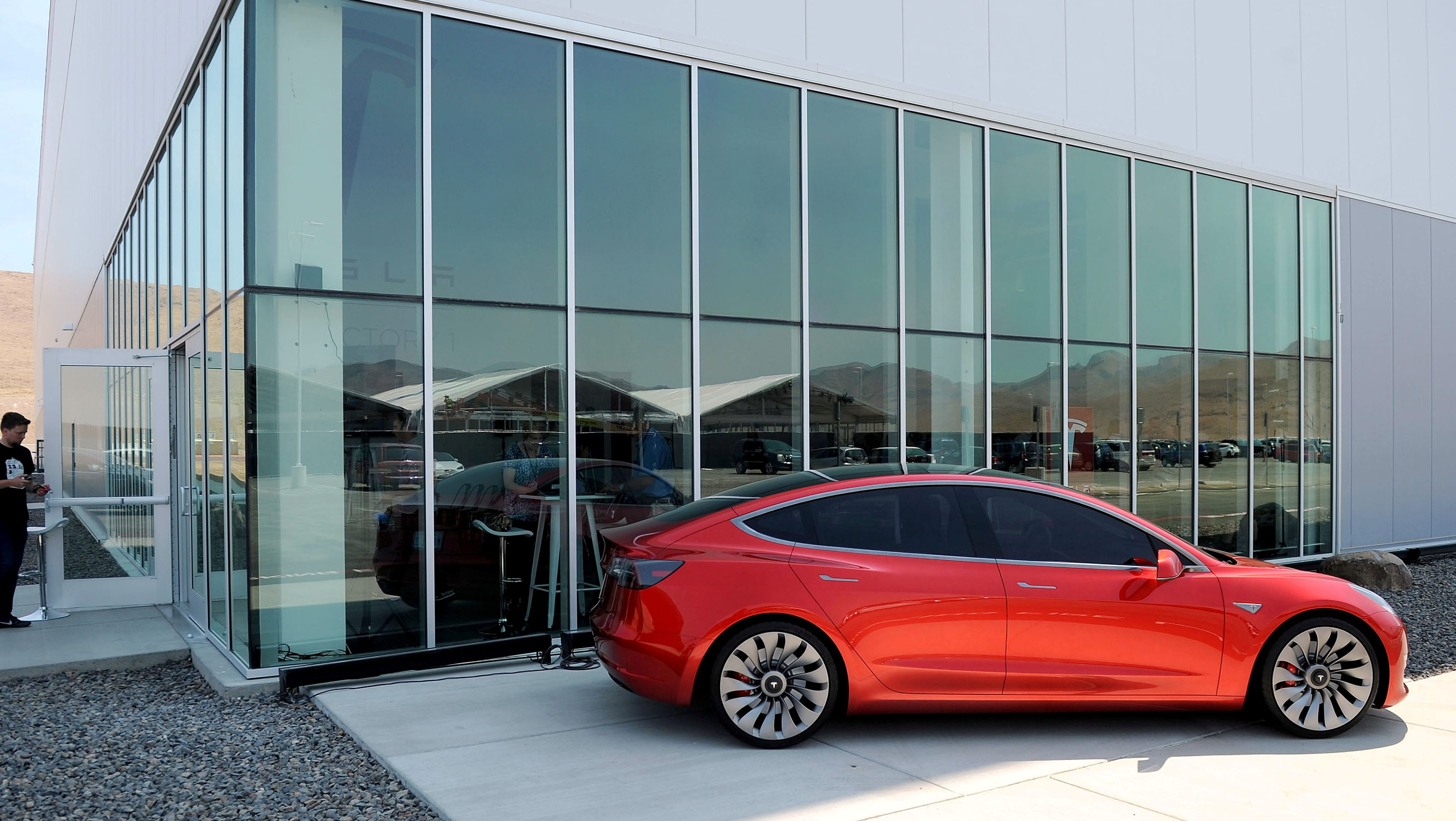 FILE PHOTO: A prototype of the Tesla Model 3 is on display in front of the factory during a media tour of the Tesla Gigafactory which will produce batteries for the electric carmaker in Sparks, Nevada, U.S. July 26, 2016. REUTERS/James Glover II/File Photo - RTS1459H
