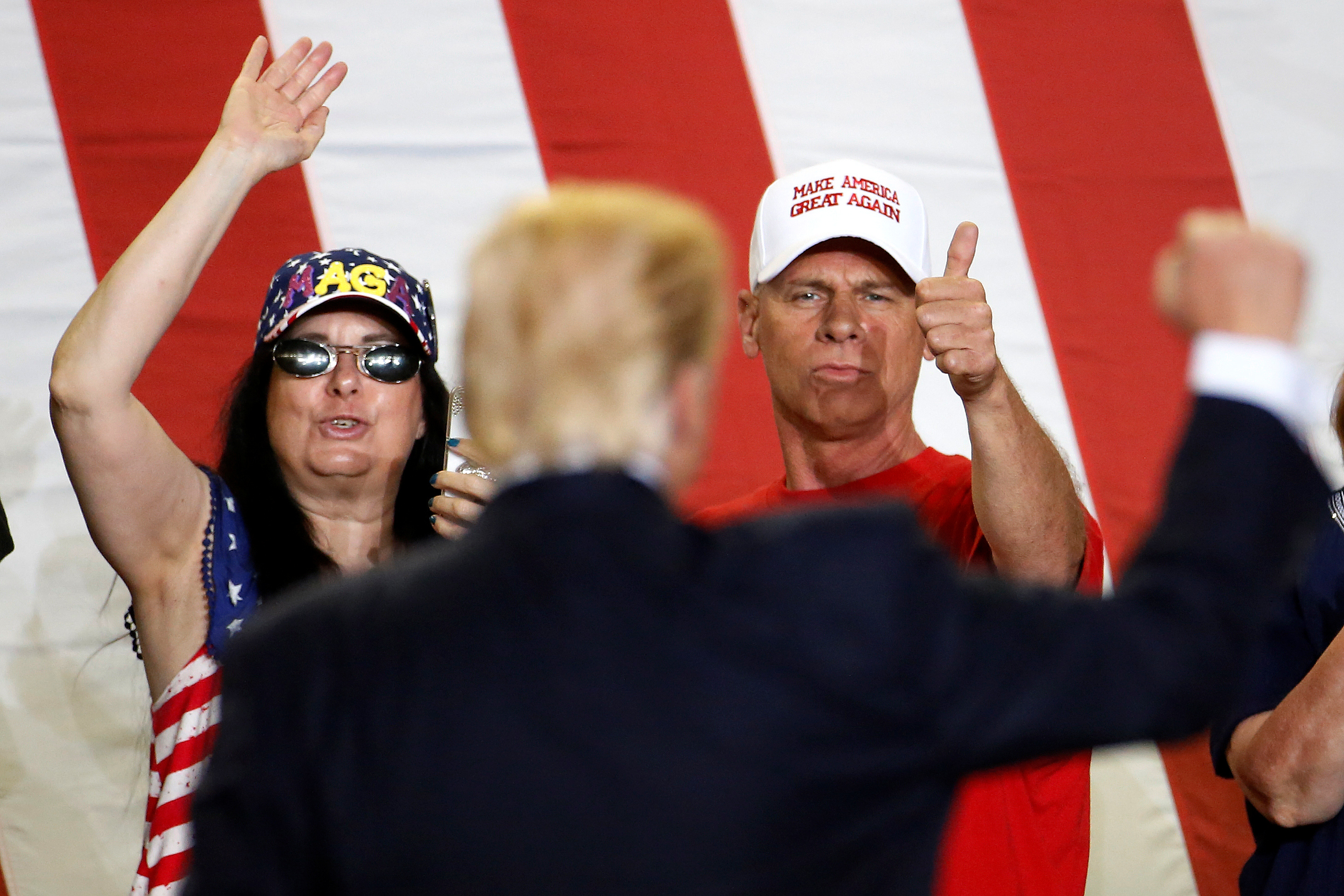 People cheer as US President Donald Trump appears on stage at a rally in Harrisburg, Pennsylvania, US on April 29, 2017.