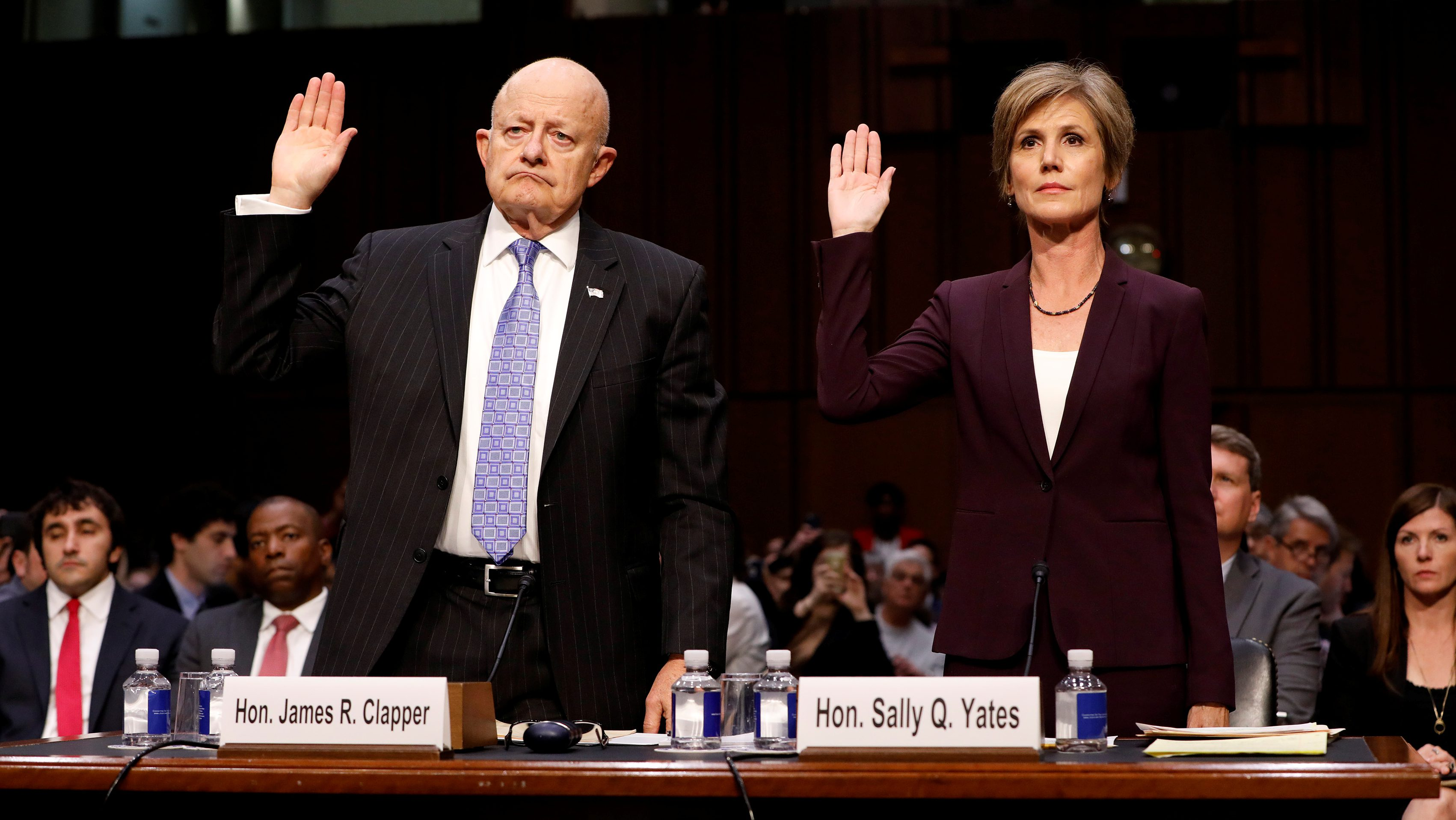 Former Acting Attorney General Sally Yates and former Director of National Intelligence James Clapper are sworn in before the Senate Judiciary Committee on Capitol Hill