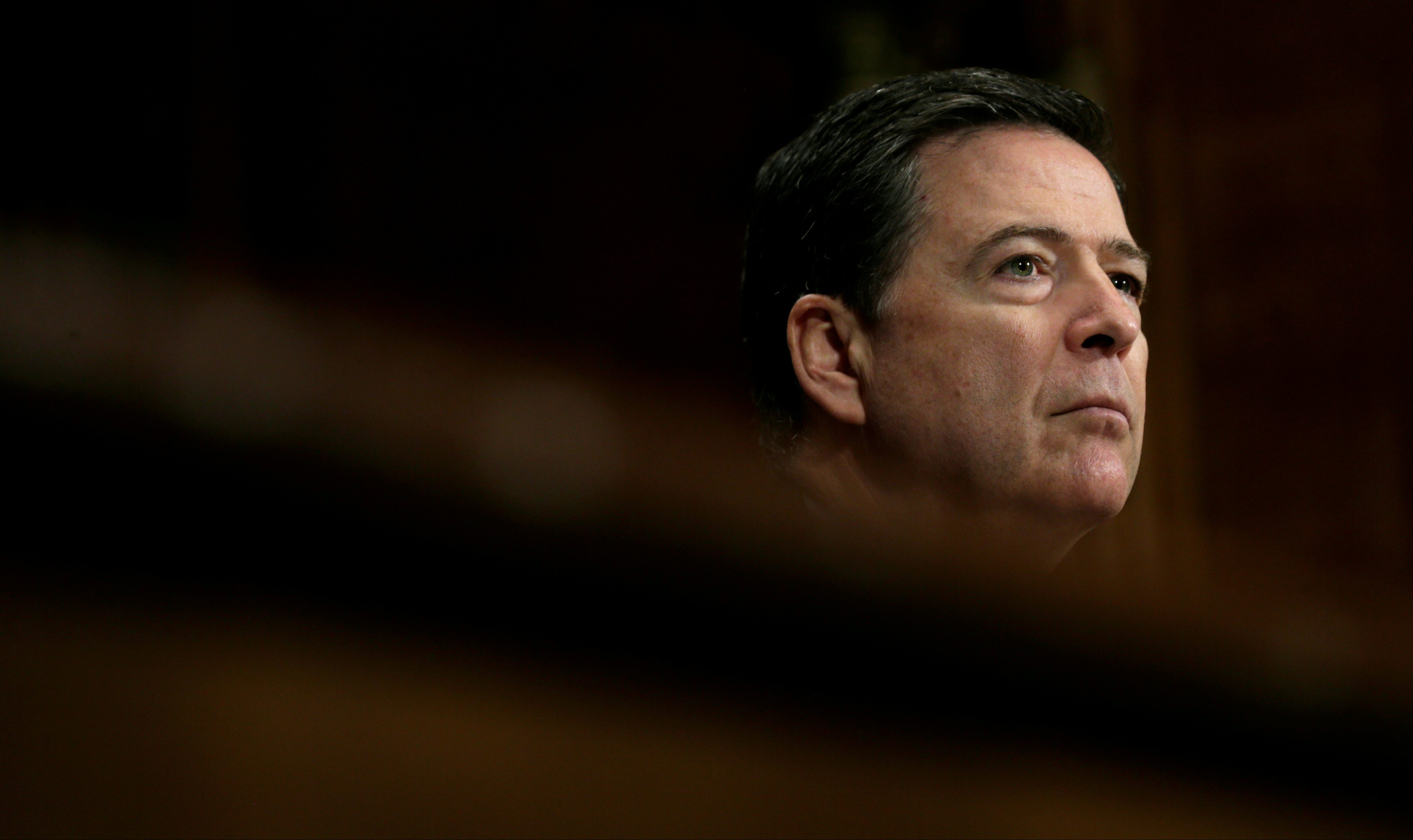 """FILE PHOTO: FBI Director James Comey testifies before a Senate Judiciary Committee hearing on """"Oversight of the Federal Bureau of Investigation"""" on Capitol Hill in Washington, U.S., May 3, 2017. REUTERS/Kevin Lamarque/File Photo - RTS15WUX"""