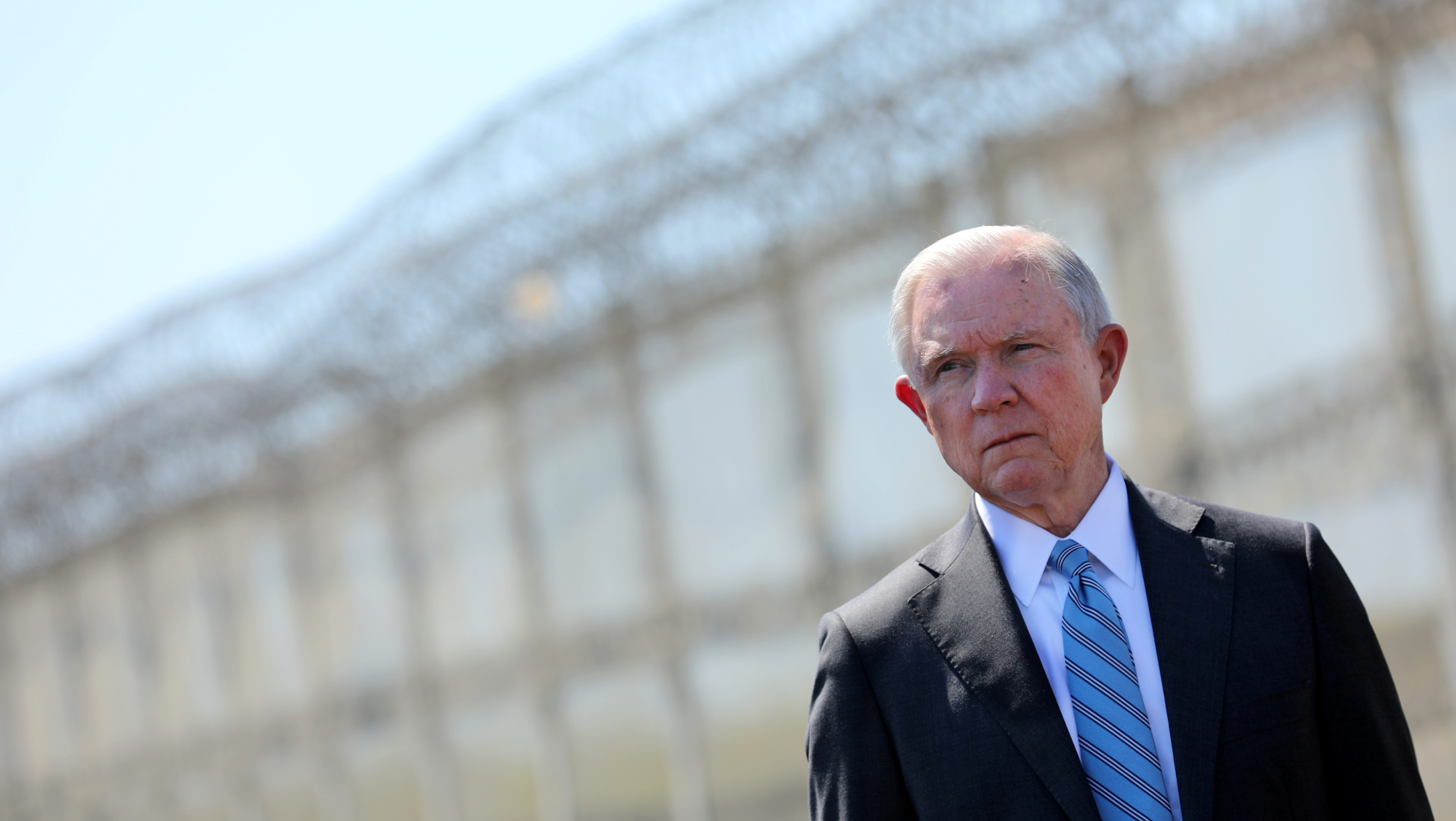 FILE PHOTO: Attorney General Jeff Sessions looks out towards Mexico as he stands by a secondary border fencer during visit to the U.S. Mexico border fence in San Diego, California, U.S. April 21, 2017.  REUTERS/Mike Blake/File Photo - RTS15WXF