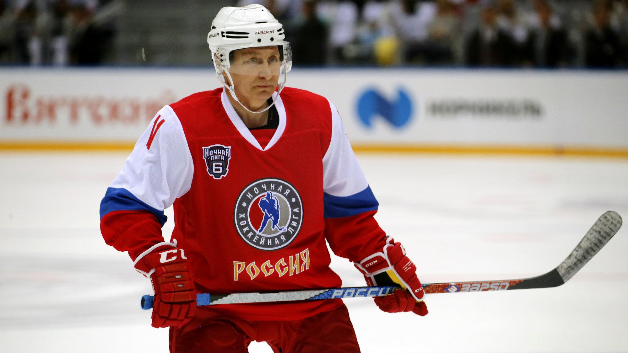 Vladimir Putin playing hockey