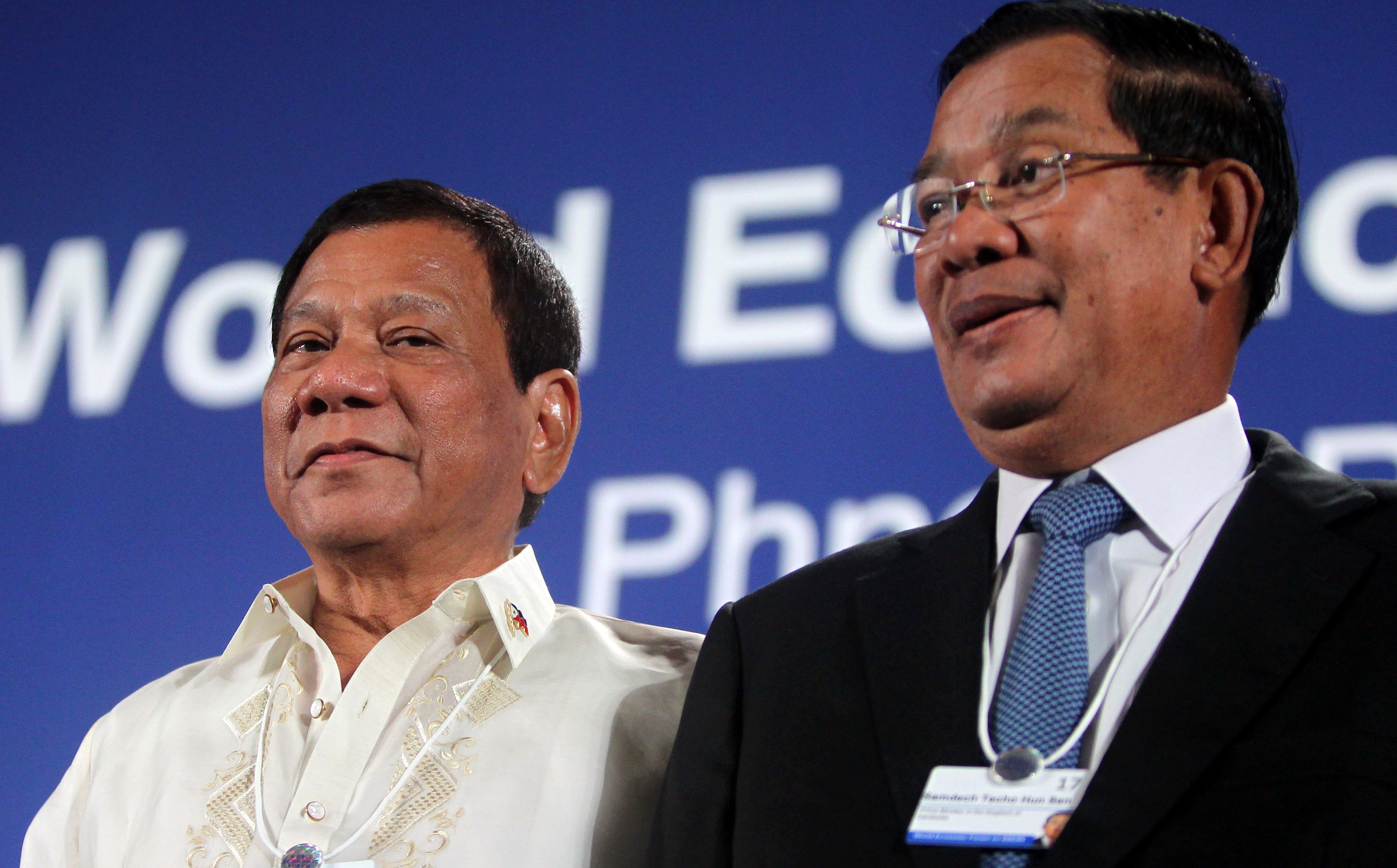 Philippine President Rodrigo Duterte and Cambodia's Prime Minister Hun Sen attend the World Economic Forum on ASEAN at a hotel in Phnom Penh