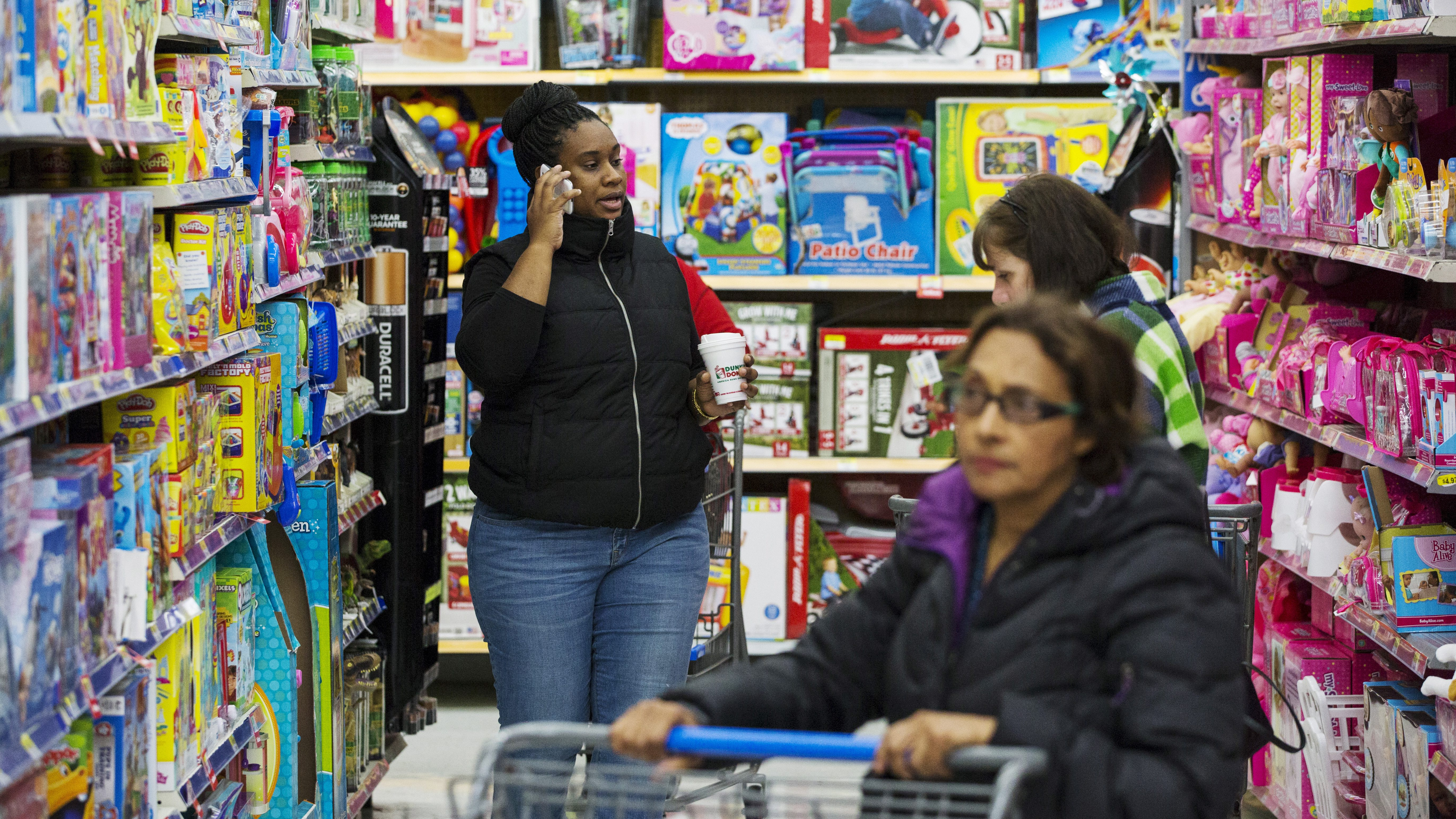 Shoppers look at merchandise at a Walmart store in Secaucus, New Jersey, November 11, 2015. REUTERS/Lucas Jackson - RTS6KOO
