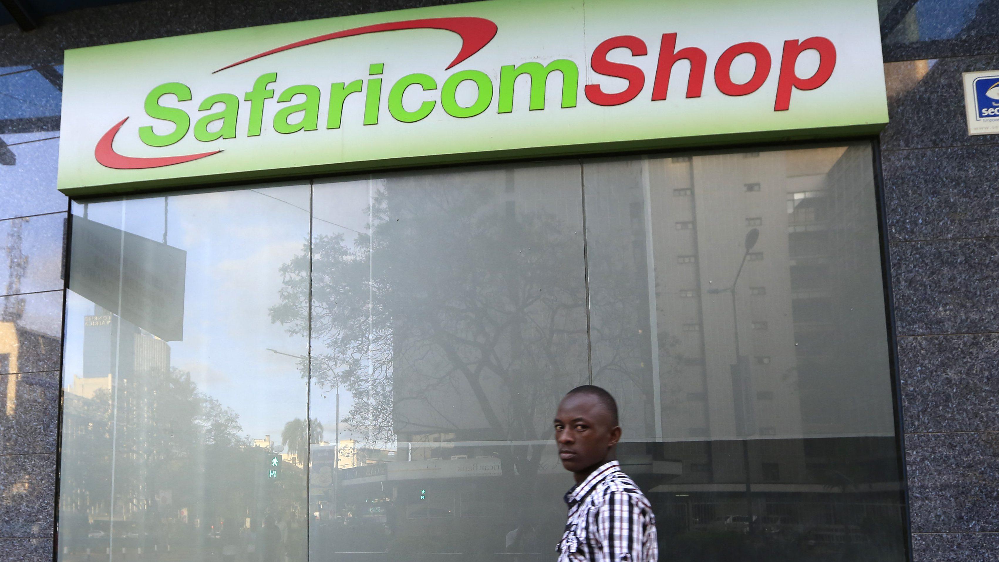 A man walks past a Safaricom shop, a mobile telecommunication provider in Kenya's capital Nairobi November 15, 2015.
