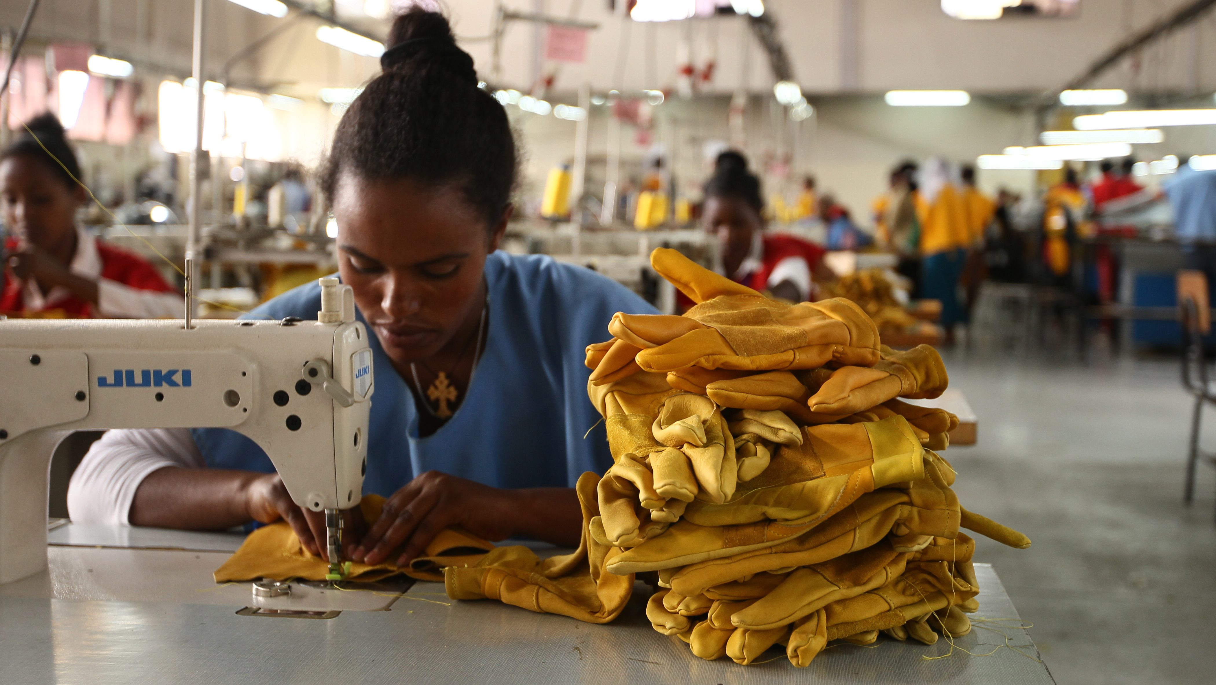 A woman stitches leather gloves at the Pittards world class leather manufacturing company in Ethiopia's capital Addis Ababa, March 22, 2016. Picture taken March 22, 2016.