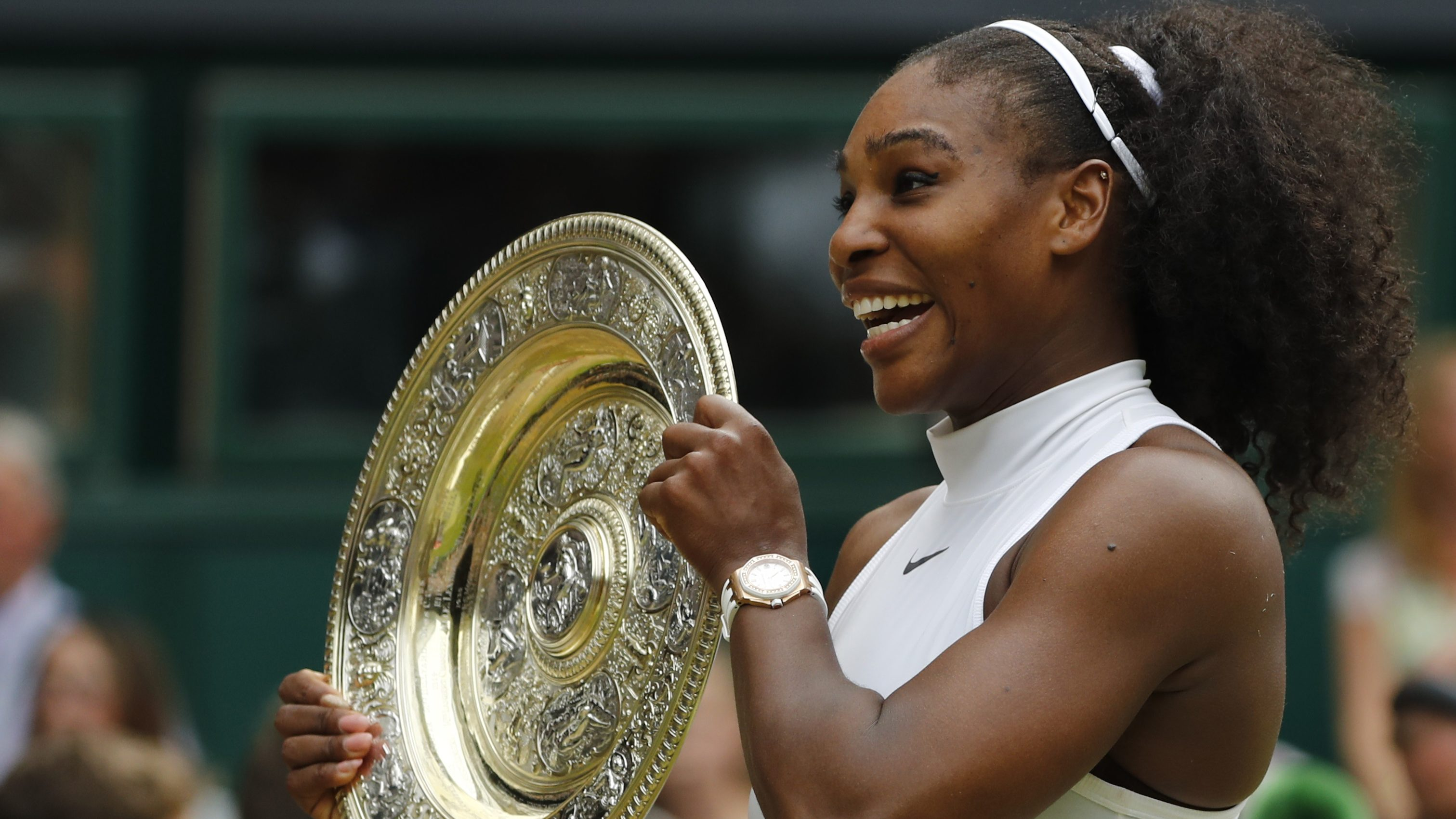 Britain Tennis - Wimbledon - All England Lawn Tennis & Croquet Club, Wimbledon, England - 9/7/16 USA's Serena Williams celebrates winning her womens singles final match against Germany's Angelique Kerber with the trophy REUTERS/Stefan Wermuth - RTSH2WM