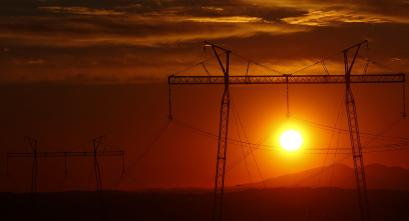 The sun sets behind electric power transmission lines near the town of Sachkhere, some 200 km (124 miles) north-west of Tbilisi, September 13, 2013. REUTERS/David Mdzinarishvili (GEORGIA - Tags: ENERGY SOCIETY BUSINESS) - RTX13KCA
