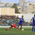 Players from Heegan (blue shirt) compete against players from Gaaddidka (red shirt) during the first soccer match of the Somalia Premier League at the Banadir stadium in Mogadishu November 8, 2013.
