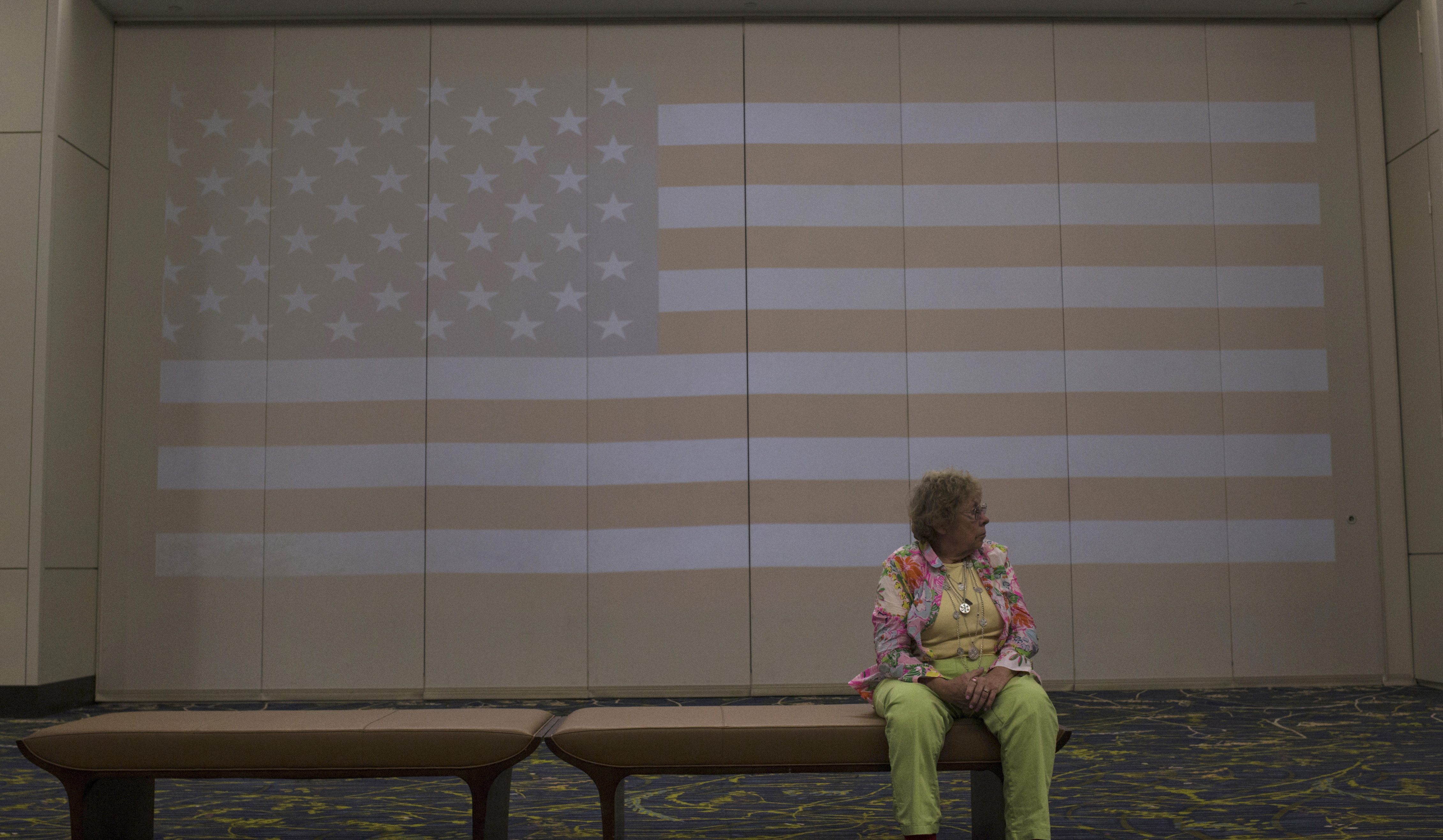 A woman waits for the start of the Republican Party of Iowa's Lincoln Dinner in Des Moines, Iowa, United States, May 16, 2015.    REUTERS/Jim Young   - RTX1D9SM