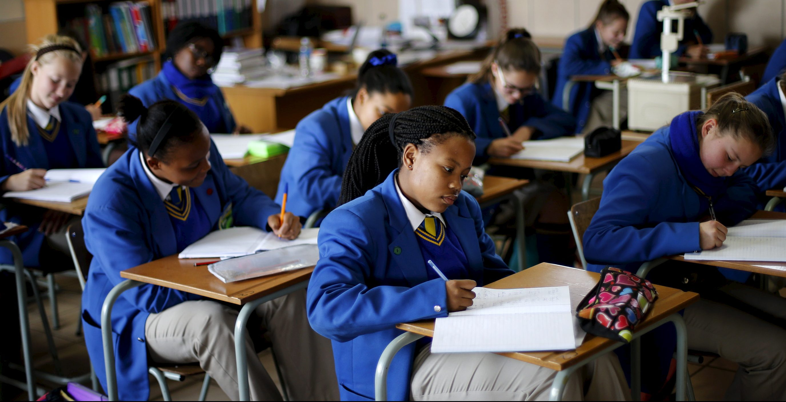 """School children attend class at Waterstone College, a private school managed by Curro in the south of Johannesburg July 22, 2015. South African private education group Advtech rejected a takeover offer from its bigger rival Curro Holdings, saying on Tuesday the proposal contained """"unacceptable pre-conditions"""". Advtech's shares fell more than 7 percent shortly after the announcement that it had rejected Curro's bid, but pared losses to close down 2.93 percent at 11.60 rand. The shares are up about 30 percent so far this year. Curro's stock shed 0.83 percent to close on 11.70 rand."""