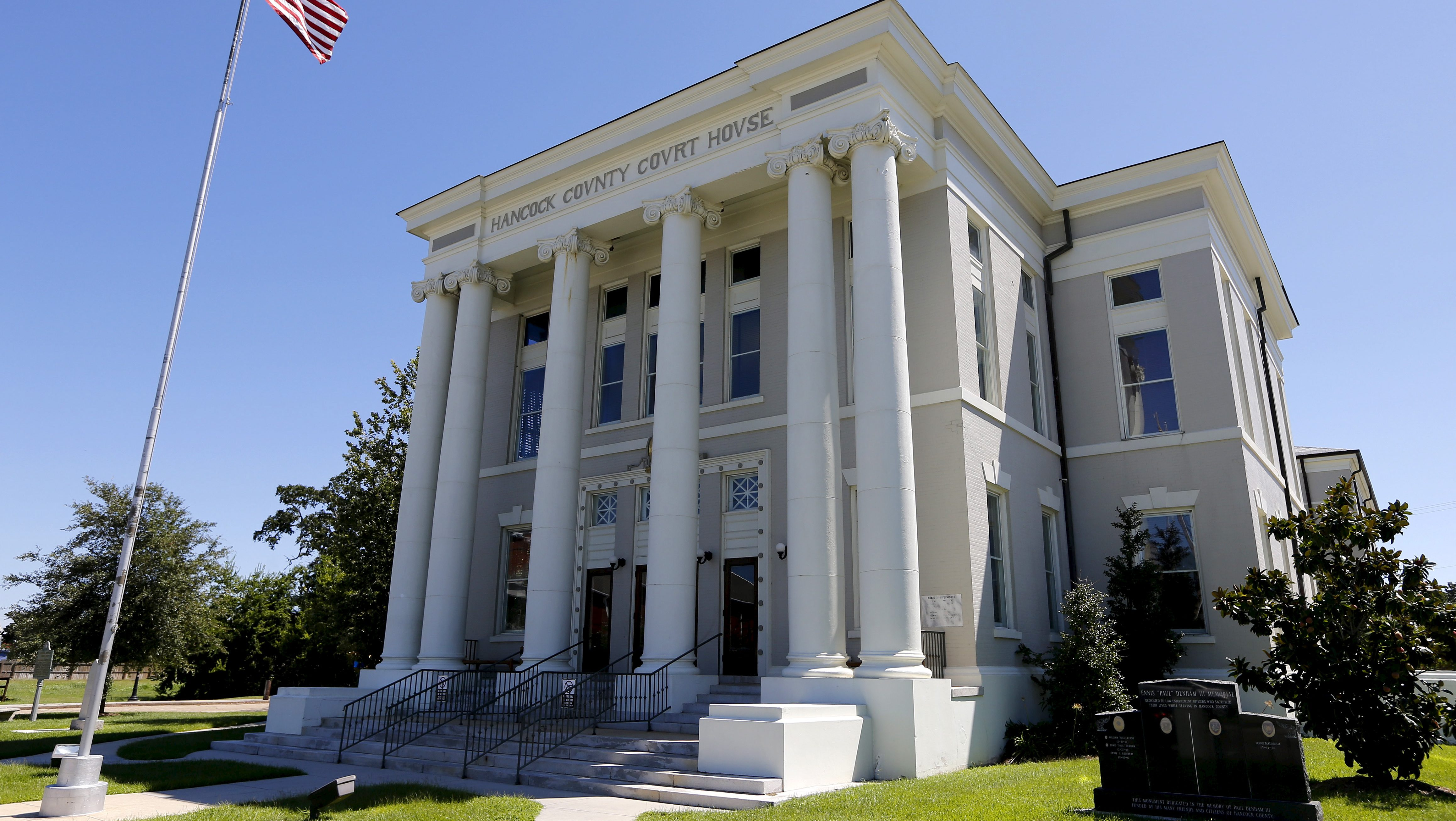 The Hancock County court house is pictured in Bay St. Louis, Mississippi, August 26, 2015. Ten years ago this week, the eye of Hurricane Katrina ripped through Pass Christian and Bay St. Louis, which face each other across a small bay 60 miles (97 km) east of New Orleans. The storm, the costliest disaster of its kind in U.S. history, caused some of the worst damage in the region here, leaving few buildings standing, killing dozens and forcing thousands to flee. The appearance now is one of impressive regeneration, thanks in part to government grants that helped these towns and others nearby recover more quickly than some urban areas of New Orleans. But behind the fresh white paint of the city buildings and the growing optimism, there are signs of persistent difficulties for these picturesque towns, which can no longer rely on government grants. Picture taken August 26, 2015.     REUTERS/Jonathan Bachman - RTX1Q1NA