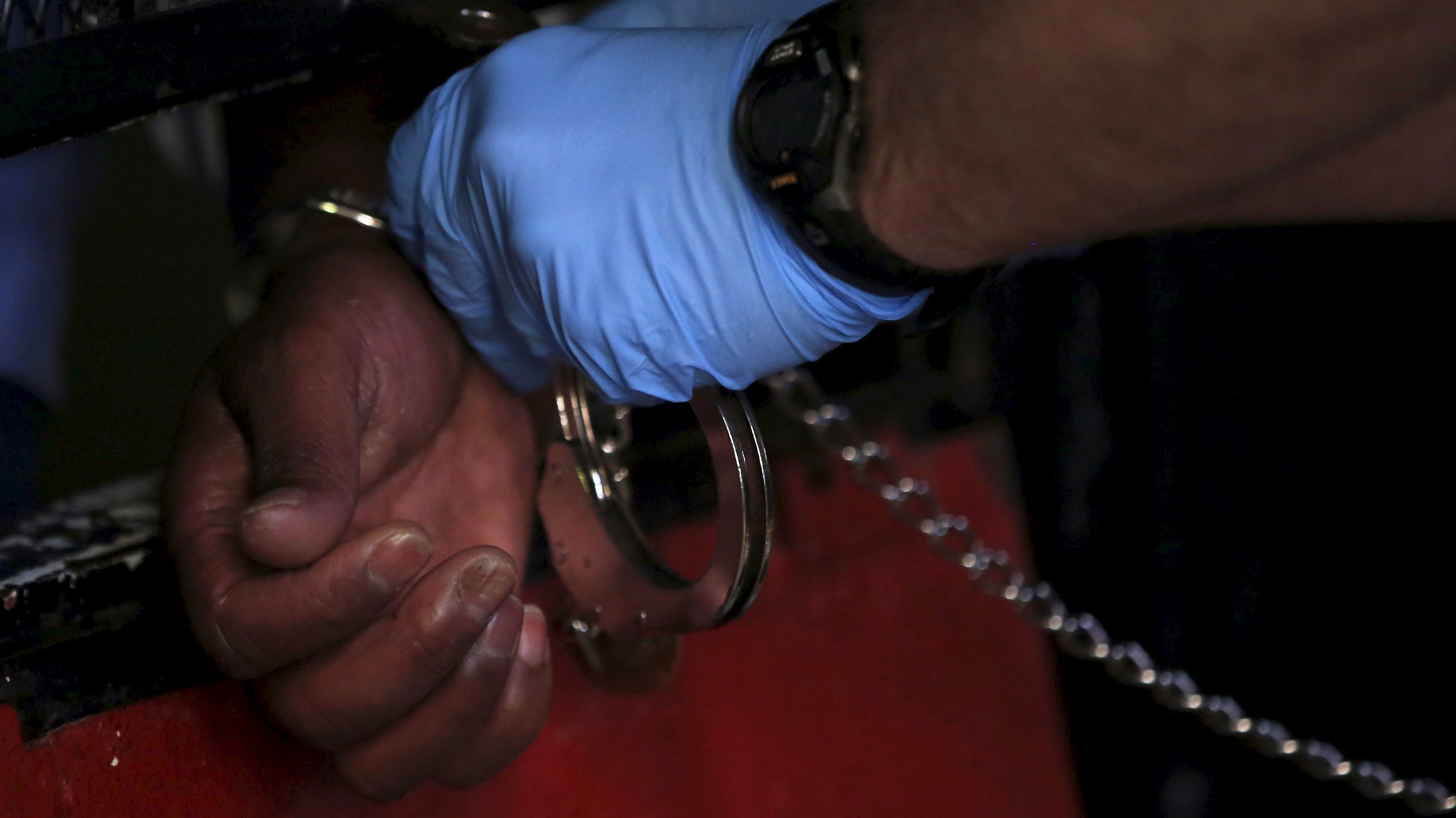 A guard opens the handcuffs of an inmate after he was escorted back into his cell in the East Block during a media tour of California's Death Row at San Quentin State Prison in San Quentin, California December 29, 2015. America's most populous state, which has not carried out an execution in a decade, begins 2016 at a pivotal juncture, as legal developments hasten the march toward resuming executions, while opponents seek to end the death penalty at the ballot box. To match Feature CALIFORNIA-DEATH-PENALTY/    Picture taken December 29, 2015. REUTERS/Stephen Lam - RTX21ECW
