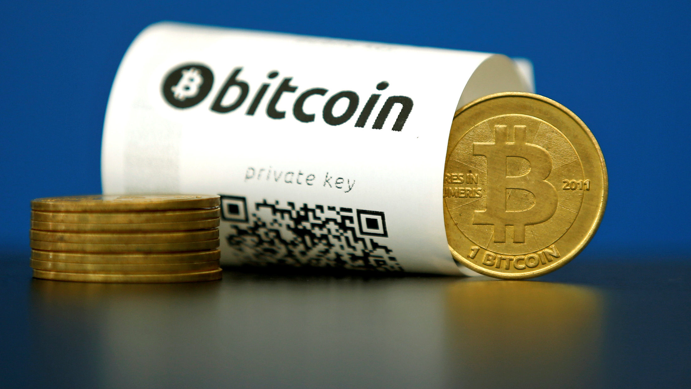 A bitcoin paper wallet with QR codes and a coin