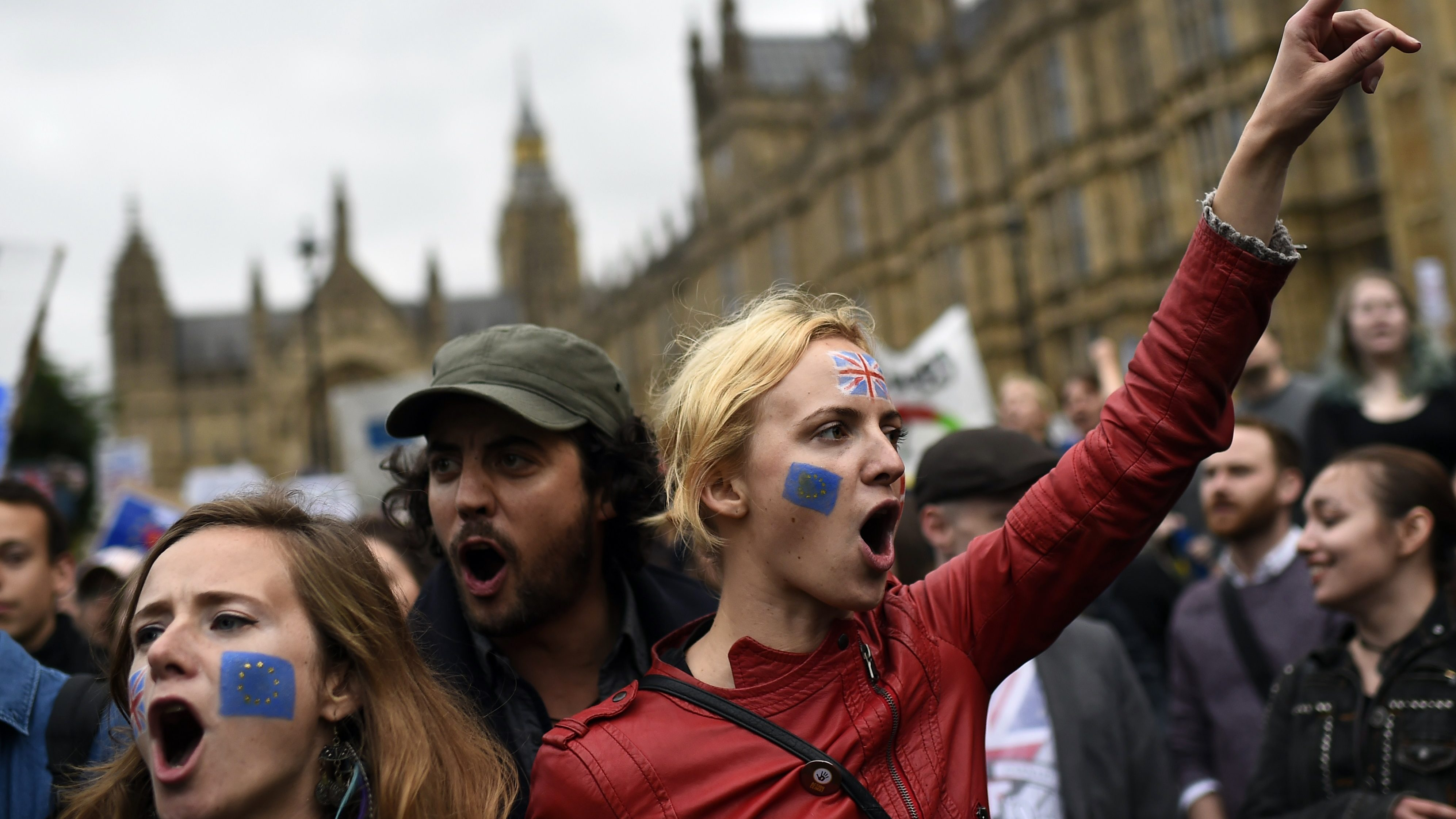 Demonstrators shout outside the Houses of Parliament during a protest aimed at showing London's solidarity with the European Union following the recent EU referendum, in central London