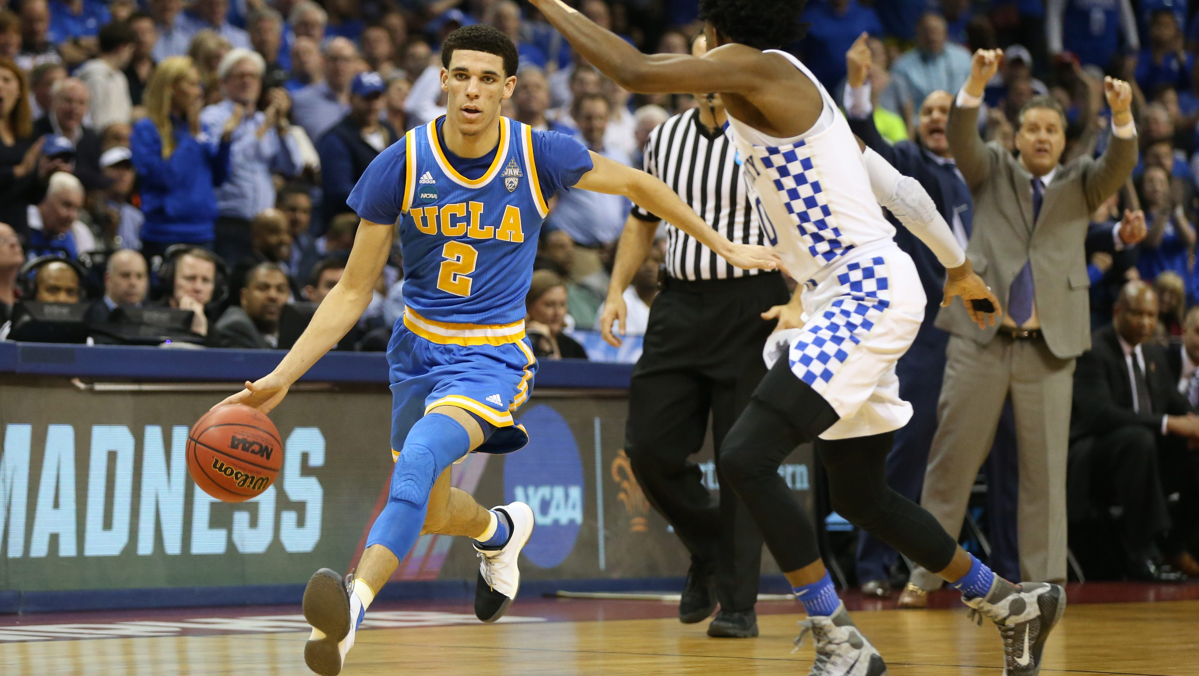 Mar 24, 2017; Memphis, TN, USA; UCLA Bruins guard Lonzo Ball (2) drives to the basket against Kentucky Wildcats guard De'Aaron Fox (0) in the second half during the semifinals of the South Regional of the 2017 NCAA Tournament at FedExForum. Mandatory Credit: Nelson Chenault-USA TODAY Sports - RTX32MPS