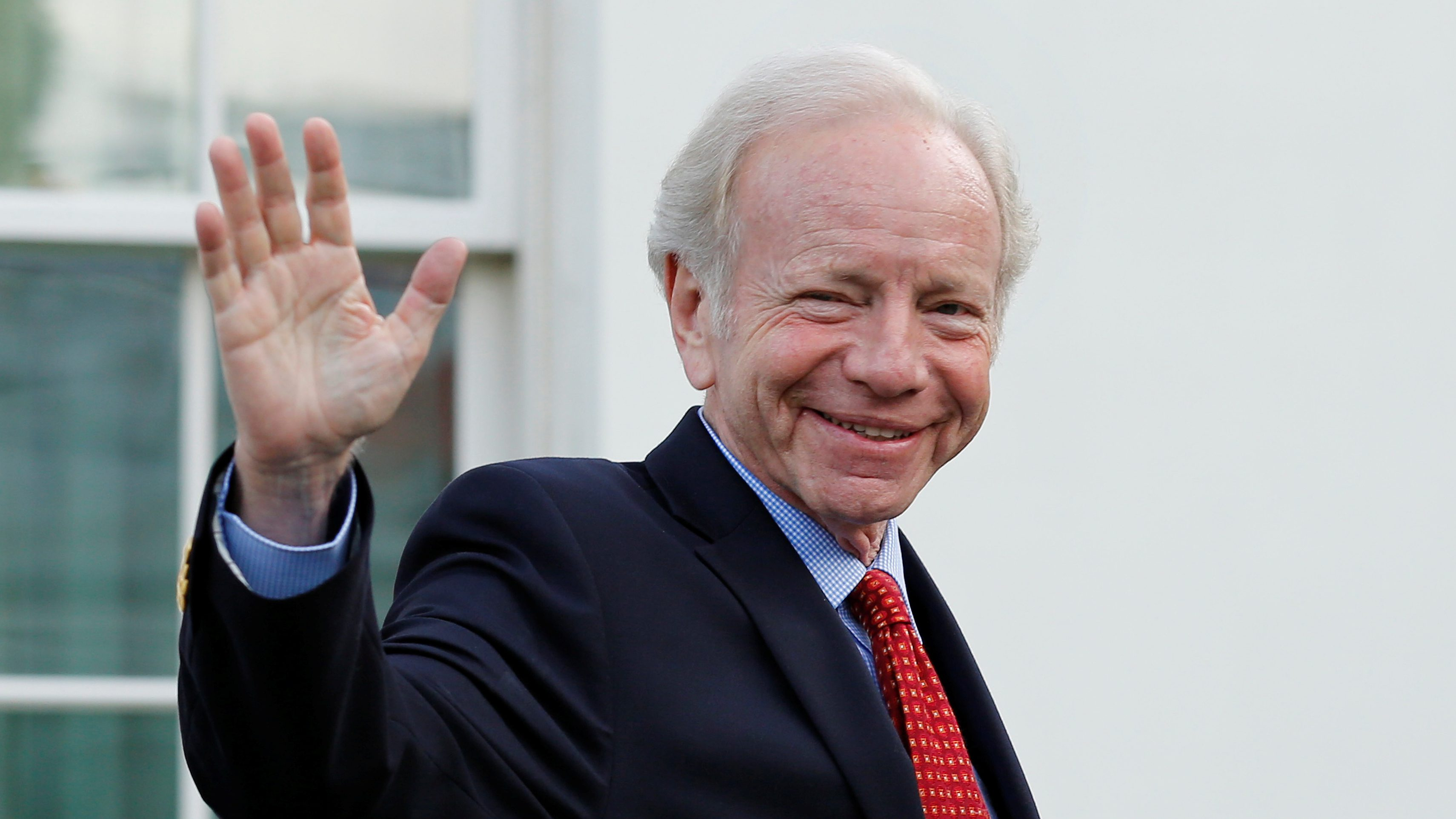 Former Senator Joe Lieberman waves as he leaves after a meeting with President Donald Trump for candidates for FBI director at the White House in Washington, U.S., May 17, 2017. REUTERS/Yuri Gripas - RTX36AX7