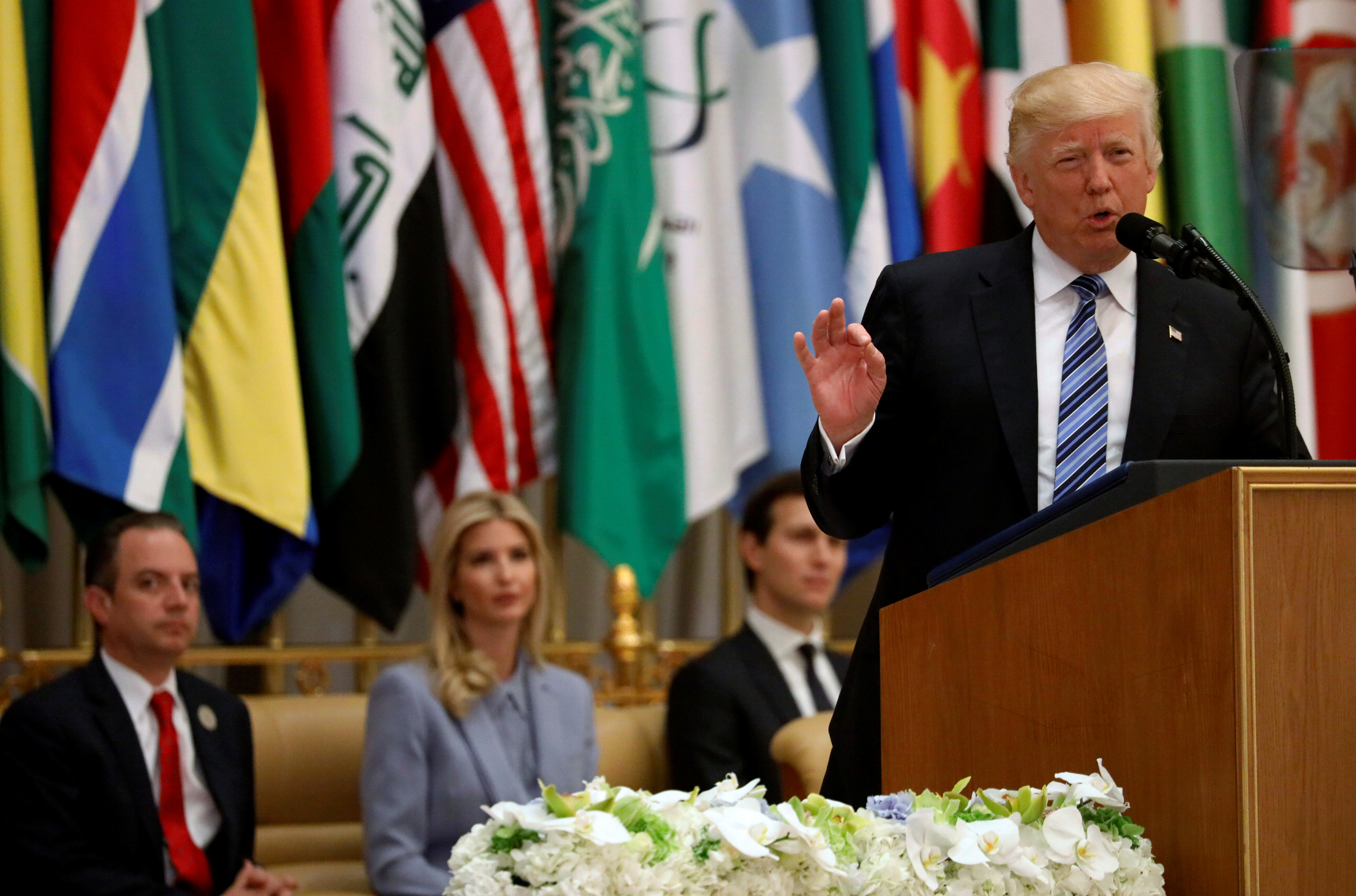 U.S. President Donald Trump, flanked by White House Chief of Staff Reince Priebus (L-R), Ivanka Trump and White House senior advisor Jared Kushner, delivers remarks to the Arab Islamic American Summit in Riyadh, Saudi Arabia May 21, 2017.  REUTERS/Jonathan Ernst - RTX36UJX
