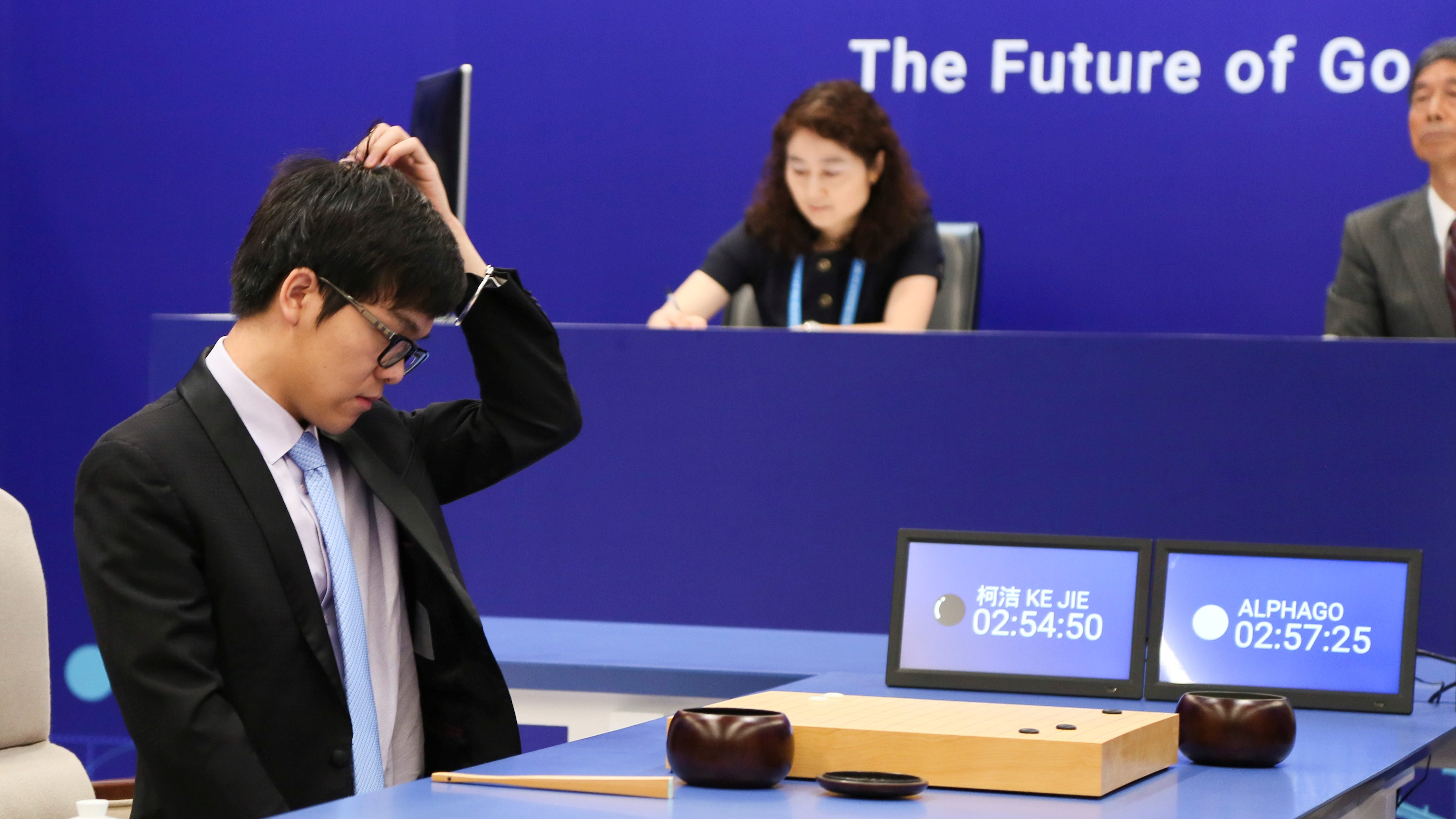 Chinese Go player Ke Jie reacts during his first match with Google's artificial intelligence program AlphaGo at the Future of Go Summit in Wuzhen, Zhejiang province, China May 23, 2017.