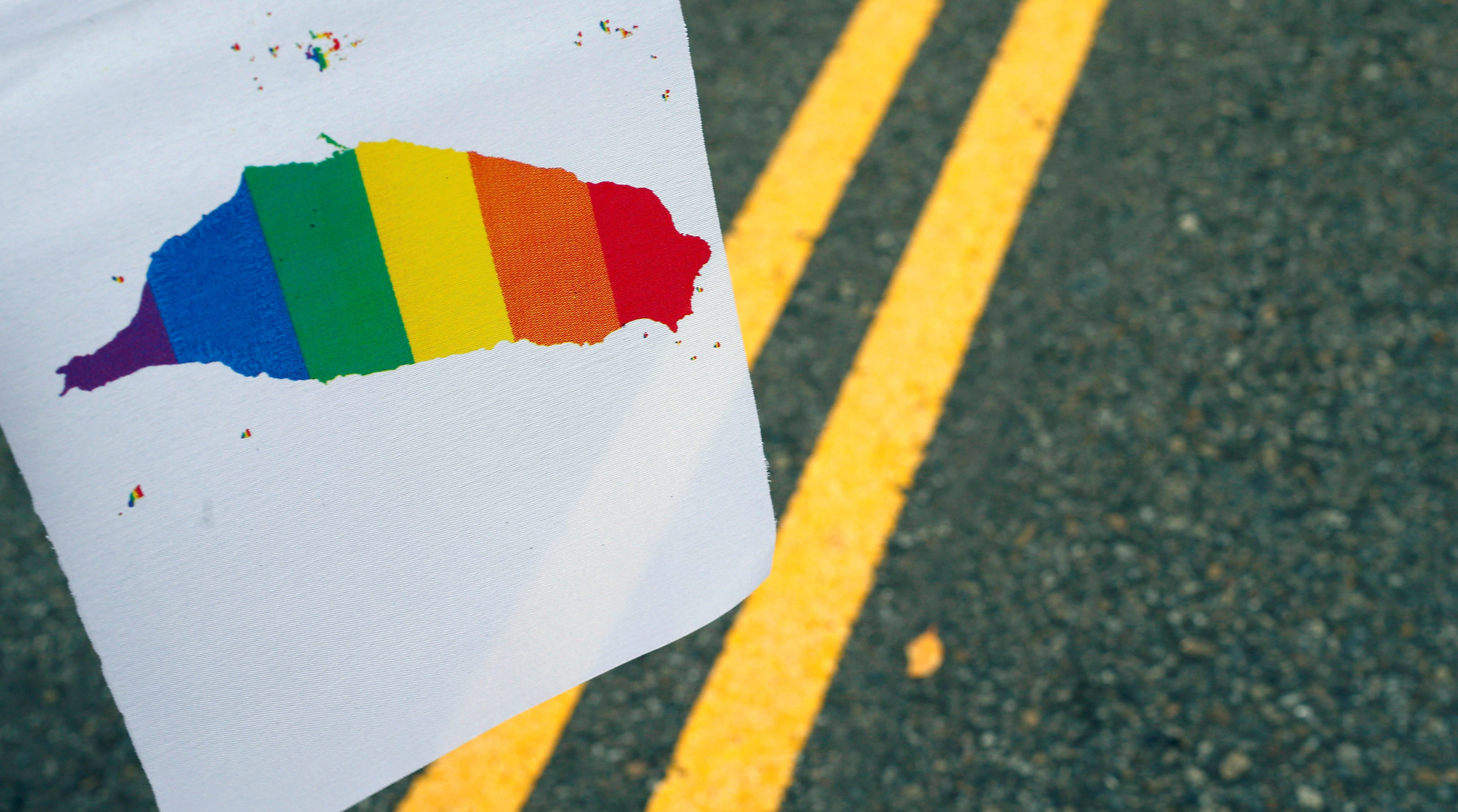 A Taiwan-shaped rainbow flag is seen during a rally ahead of Taiwan's top court ruling on same-sex marriage case which will decide whether it will become the first place in Asia to recognise same-sex marriage, in Taipei