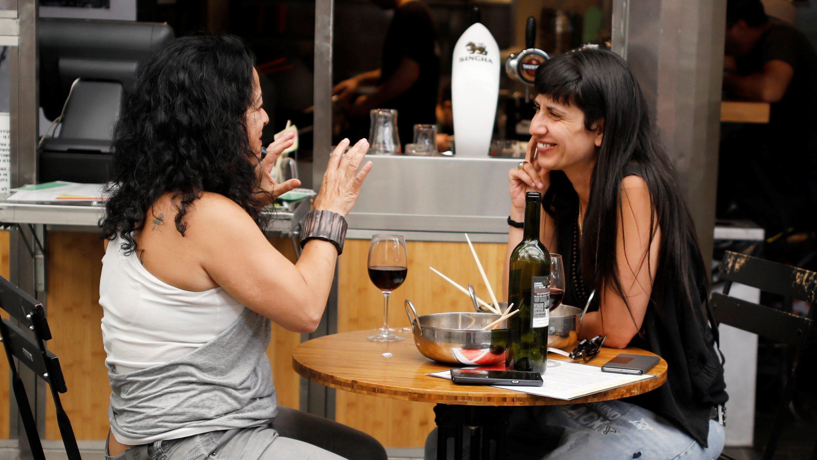 two women at an outdoor bar