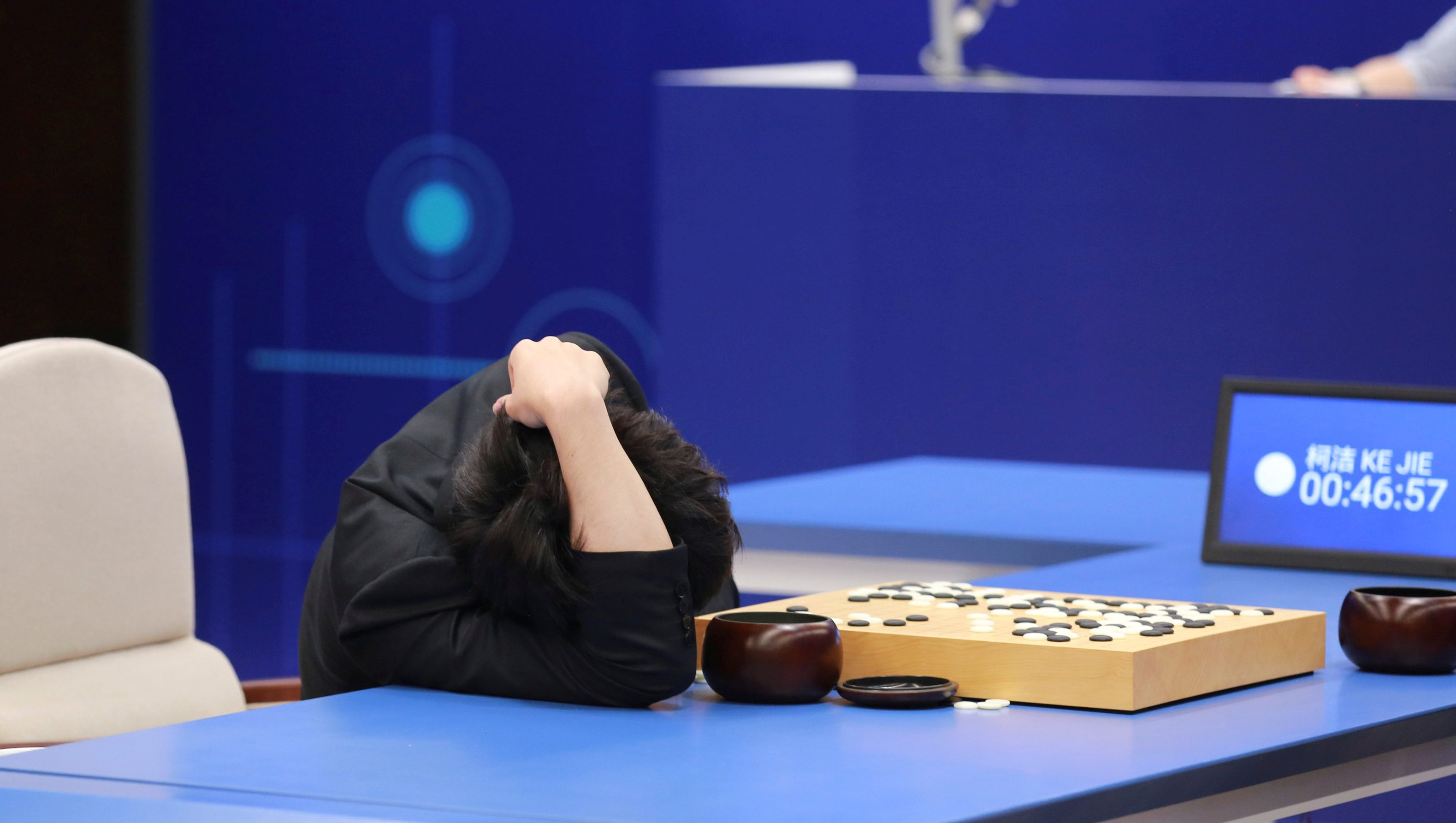 Chinese Go player Ke Jie reacts during his second match against Google's artificial intelligence program AlphaGo at the Future of Go Summit in Wuzhen
