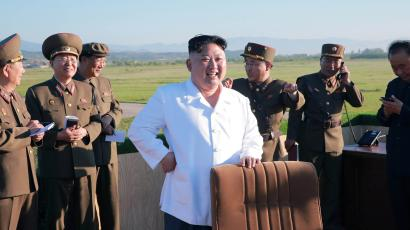 North Korean leader Kim Jong Un watches the test of a new-type anti-aircraft guided weapon system organised by the Academy of National Defence Science in this undated photo released by North Korea's Korean Central News Agency (KCNA) May 28, 2017.