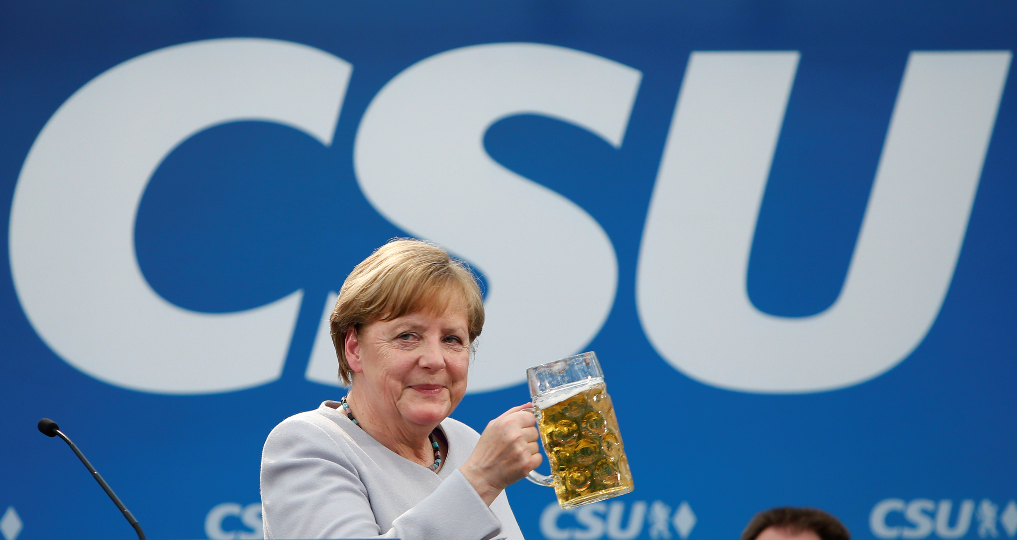 FILE PHOTO: German Chancellor and head of the Christian Democratic Union (CDU) Angela Merkel toasts during the Trudering festival in Munich, Germany, May 28, 2017.    REUTERS/Michaela Rehle/File Photo - RTX382TJ