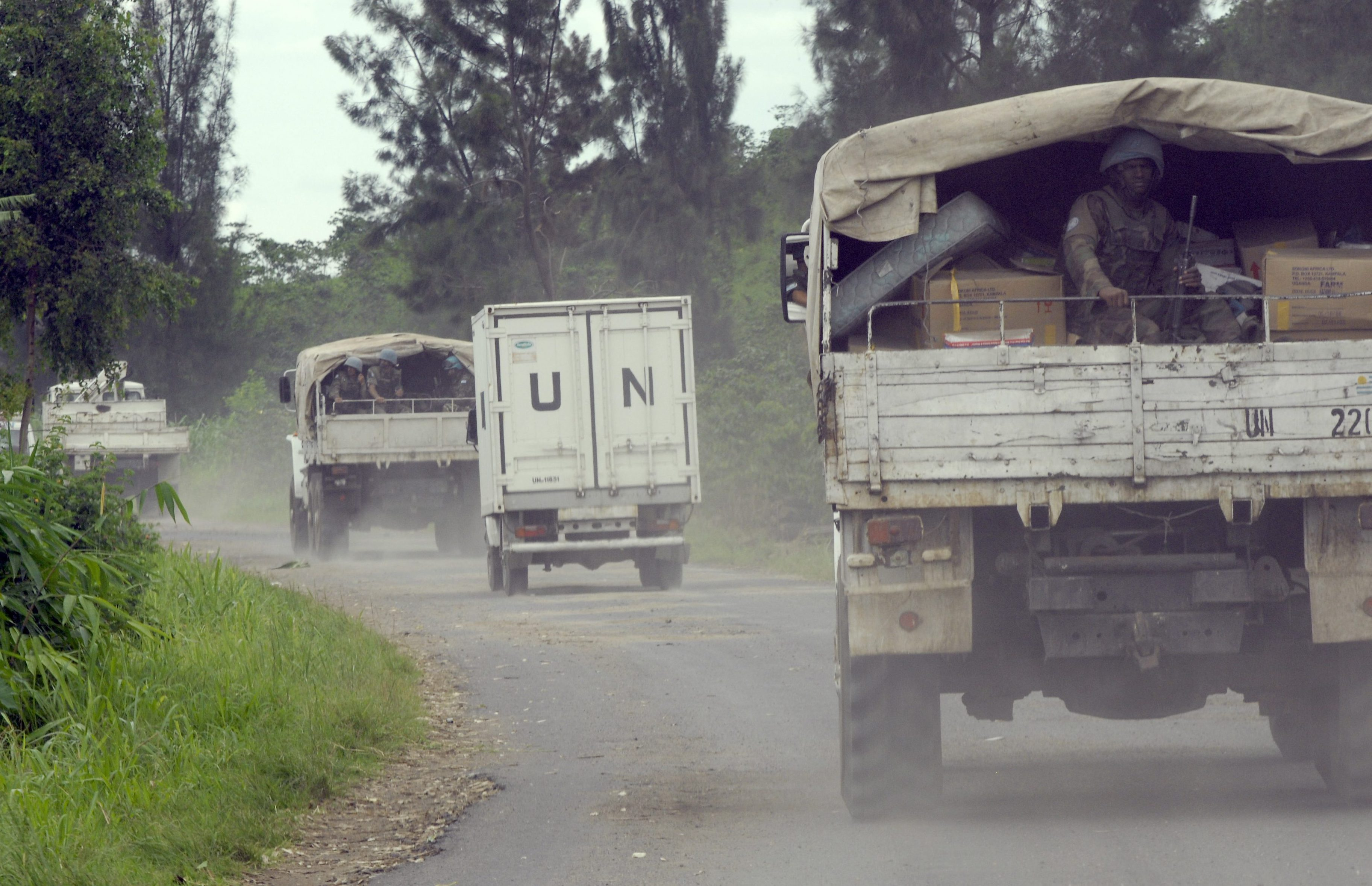 A peacekeeper sits on the back of a truck as a United Nations aid convoy escorted by U.N. peacekeepers travels to the eastern town of Rutshuru