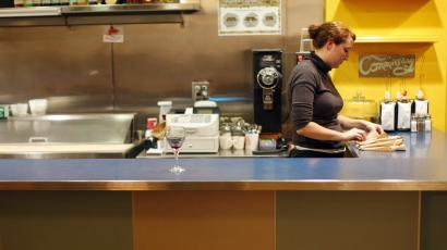 A waitress stands behind the counter at a diner in Providence, Rhode Island