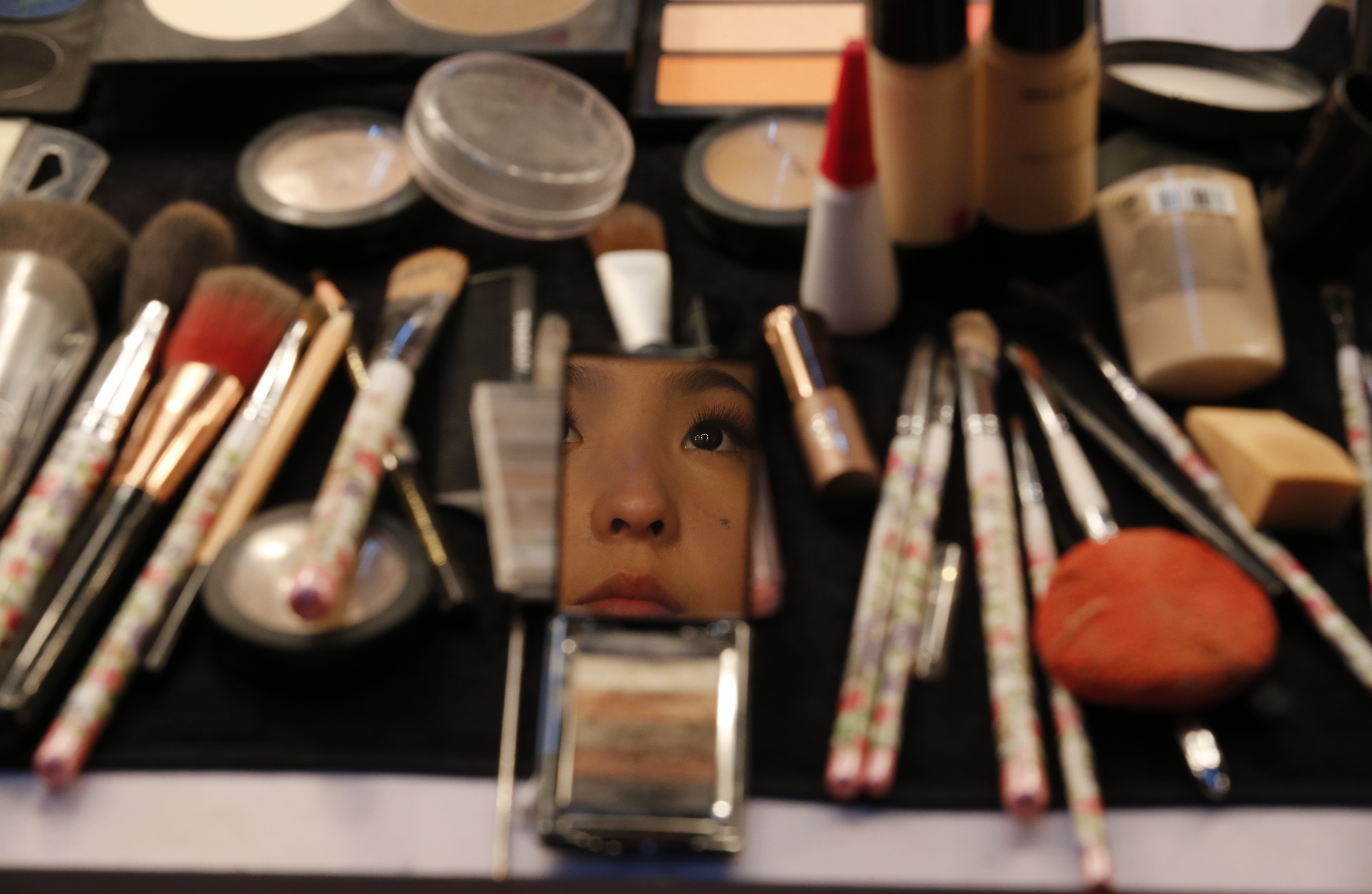 woman in mirror and makeup