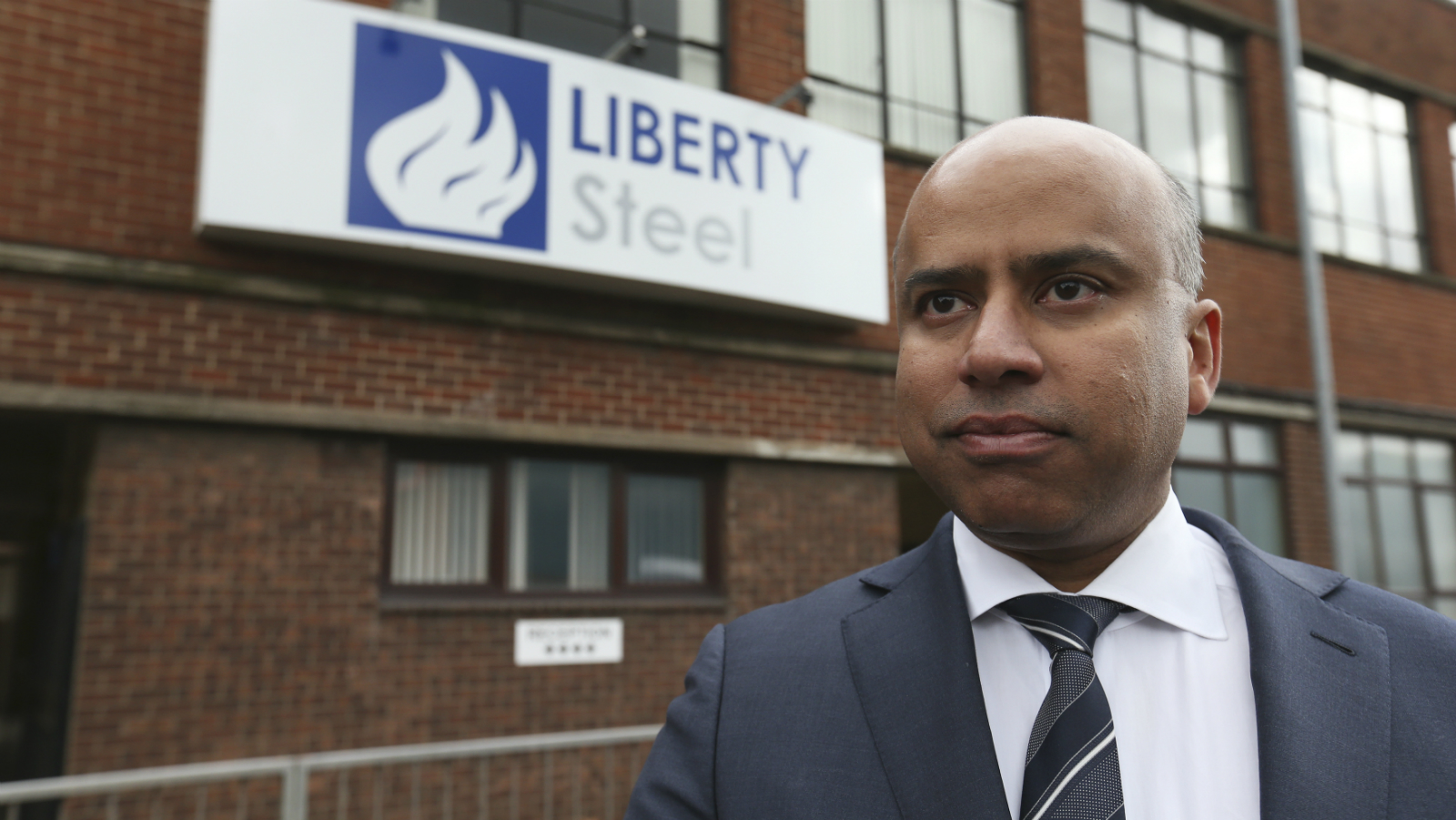 Liberty Steel boss Sanjeev Gupta stands outside steel pressing mill in Dalzell after completing its purchase, Scotland, Britain April 8, 2016.