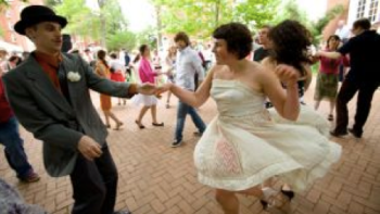 Students swing dance in a quad at St John's College