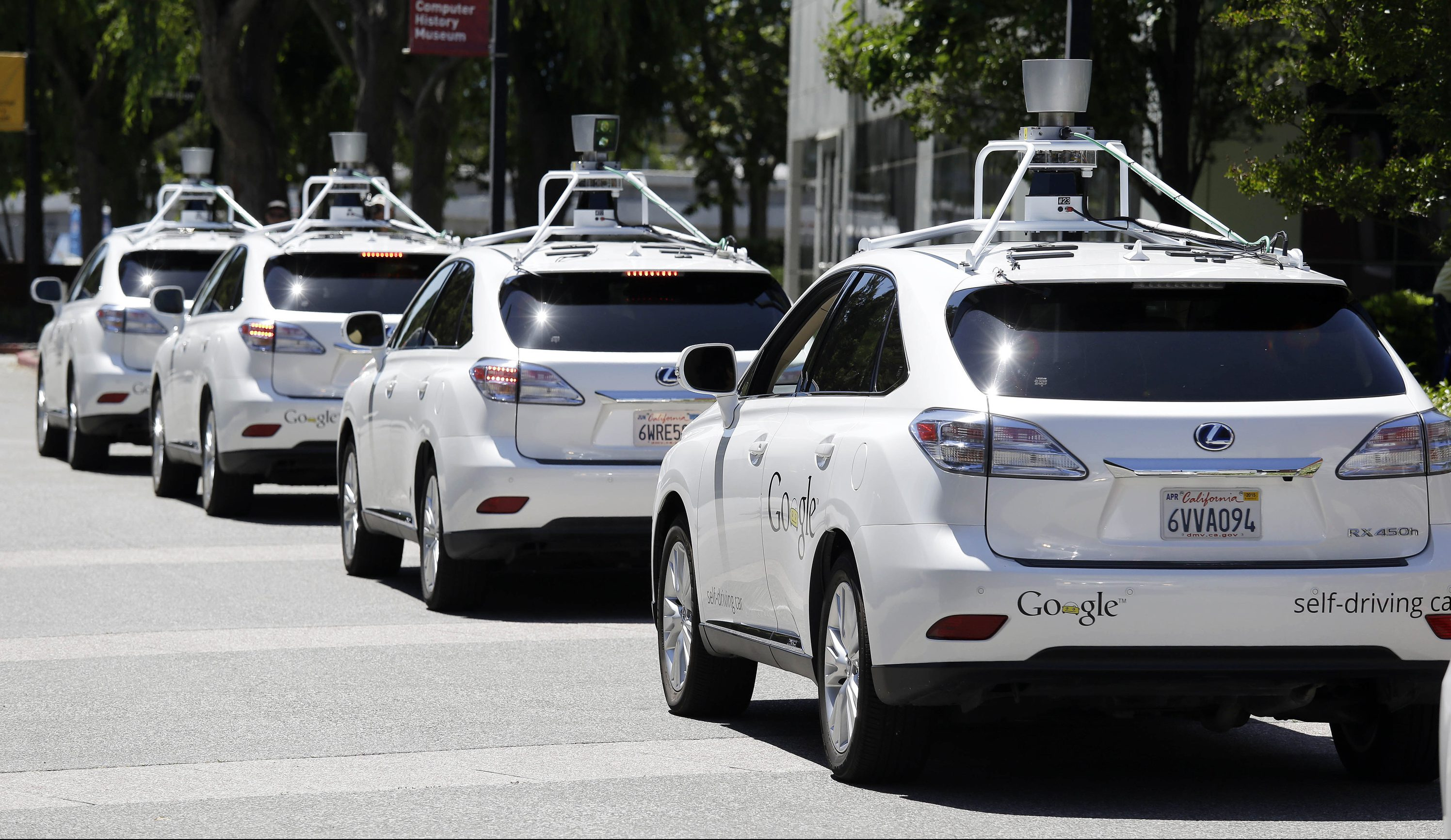 This May 13, 2014, file photo shows a row of Google self-driving Lexus cars at a Google event outside the Computer History Museum in Mountain View, Calif. California regulators release safety reports filed by 11 companies that have been testing self-driving car prototypes on public roads on Wednesday, Feb. 1, 2017.