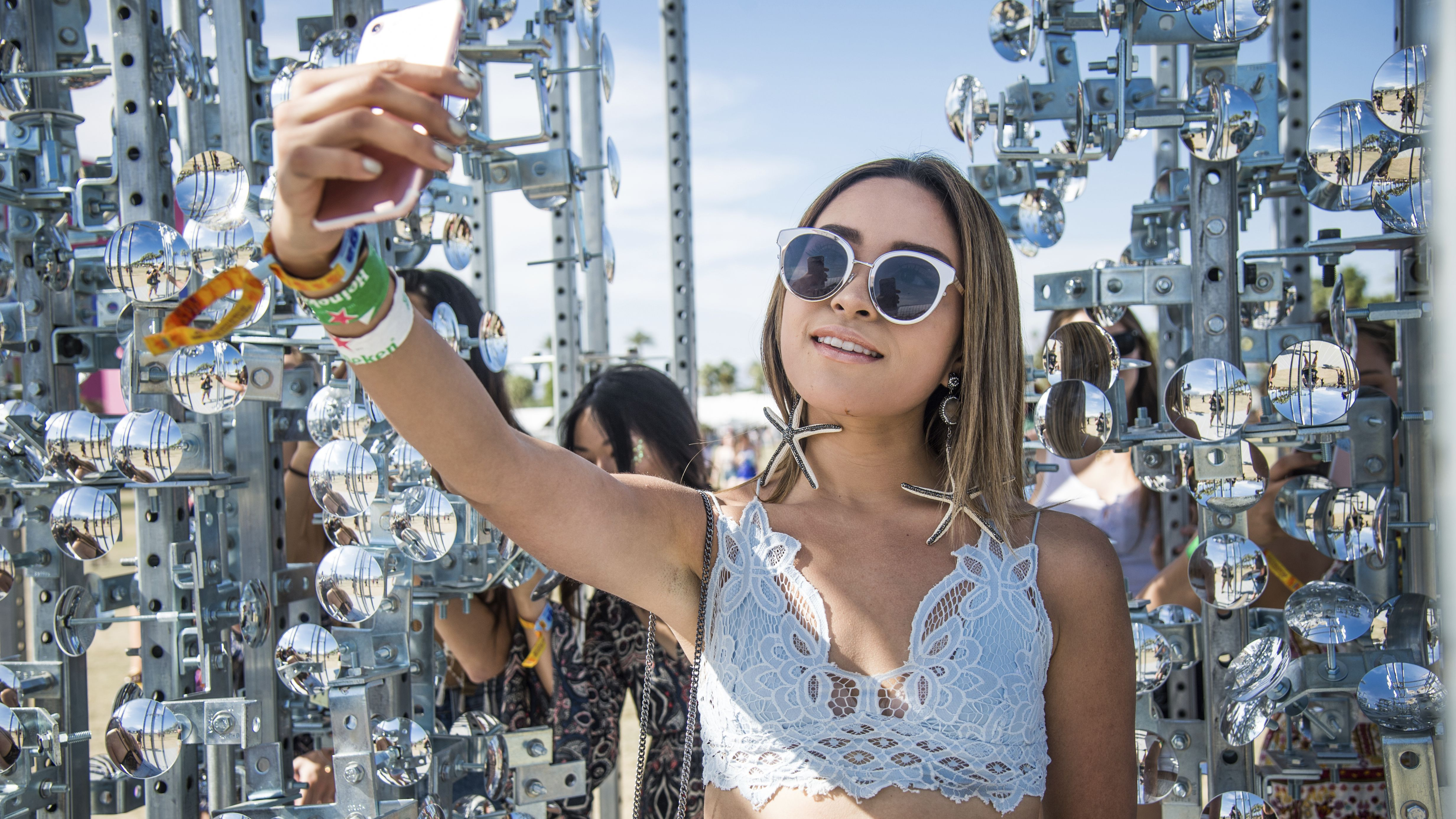 A festival goer takes a selfie at Coachella Music & Arts Festival at the Empire Polo Club on Sunday, April 16, 2017, in Indio, Calif. (Photo by Amy Harris/Invision/AP)