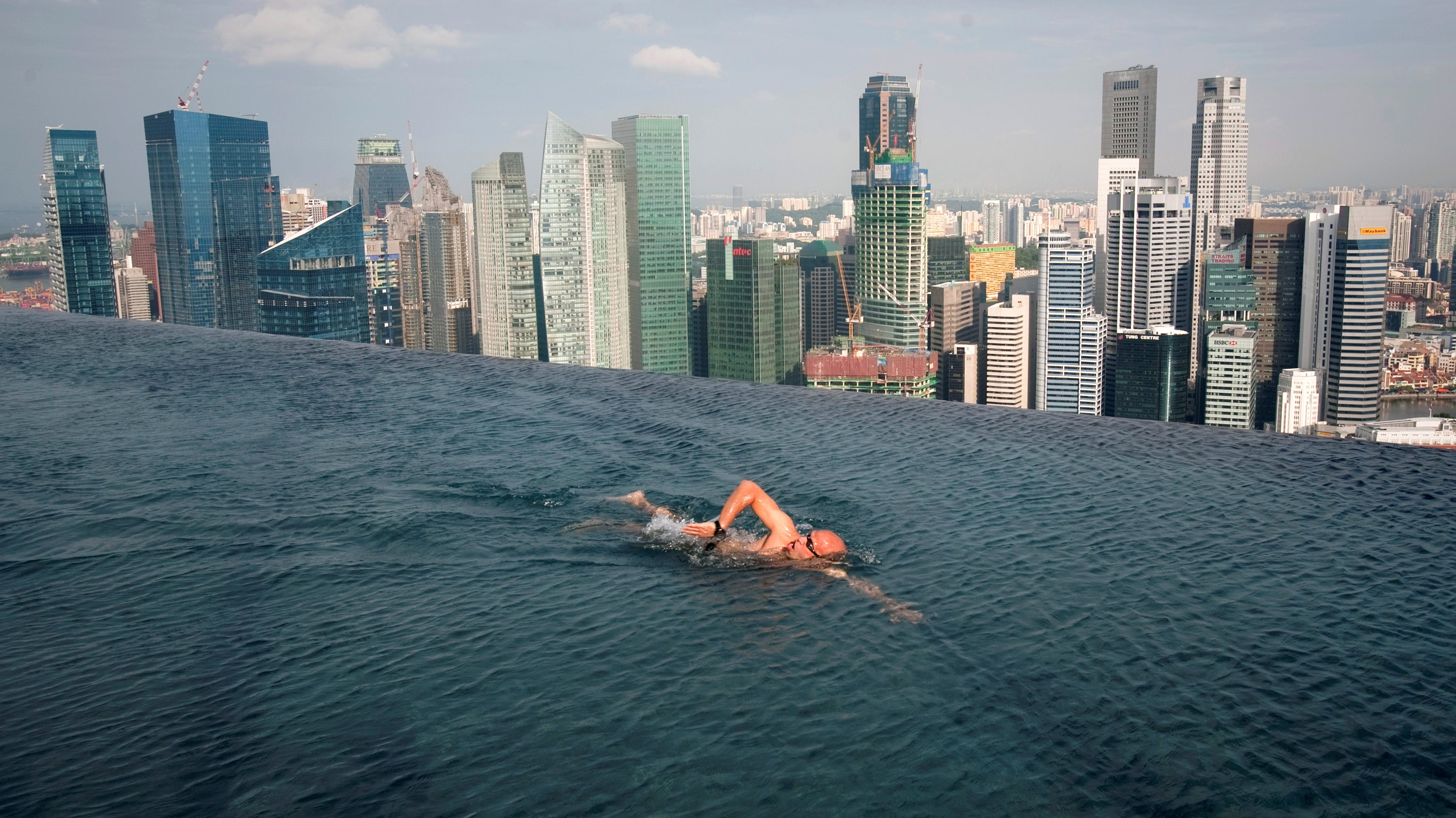 A guest swims in the infinity pool of the Skypark that tops the Marina Bay Sands hotel towers in Singapore June 24, 2010.
