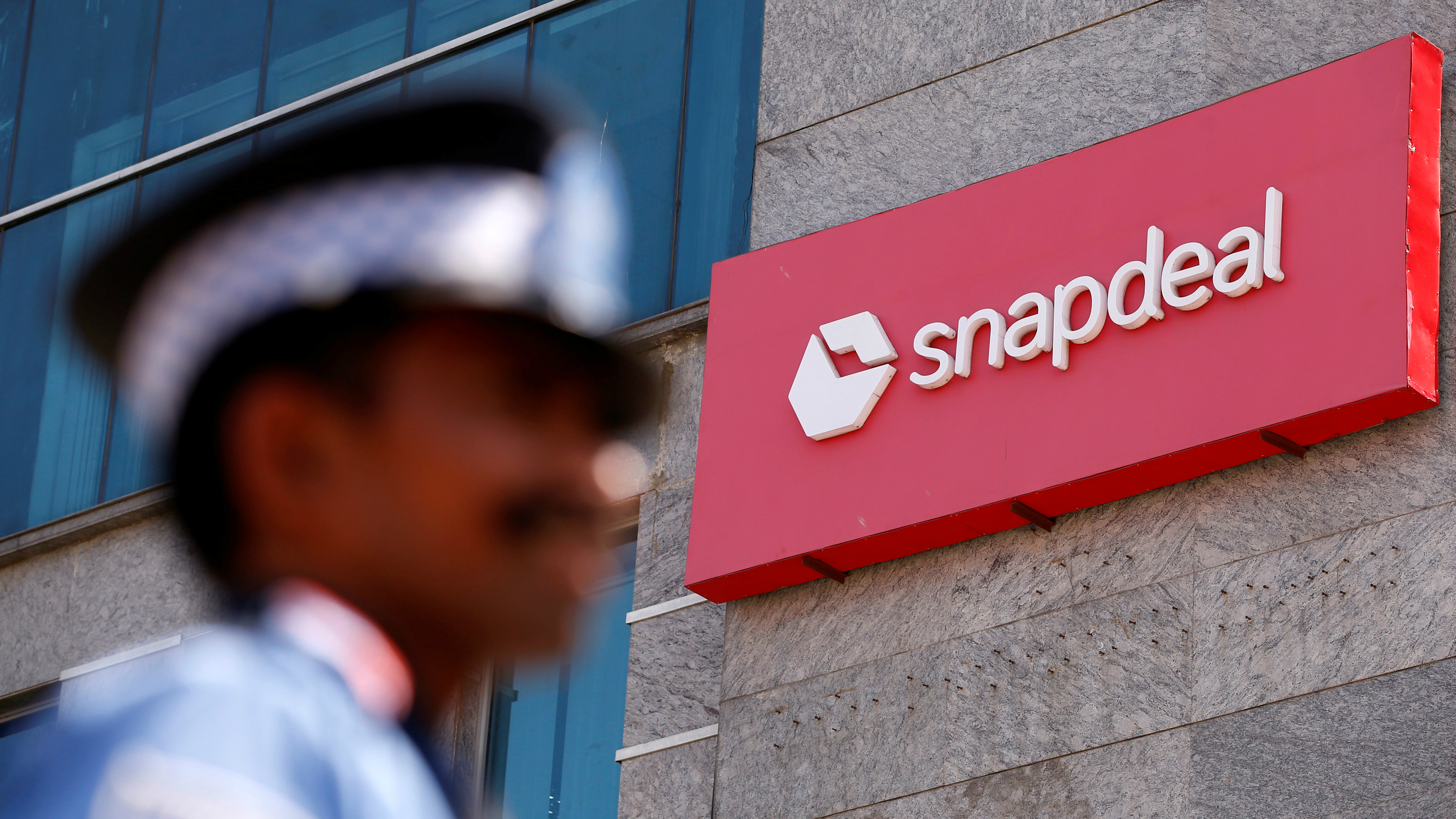 A private security gurad stands at a gate of Snapdeal headquarters in Gurugram on the outskirts of New Delhi, India, April 3, 2017. Picture taken April 3. REUTERS/Adnan Abidi