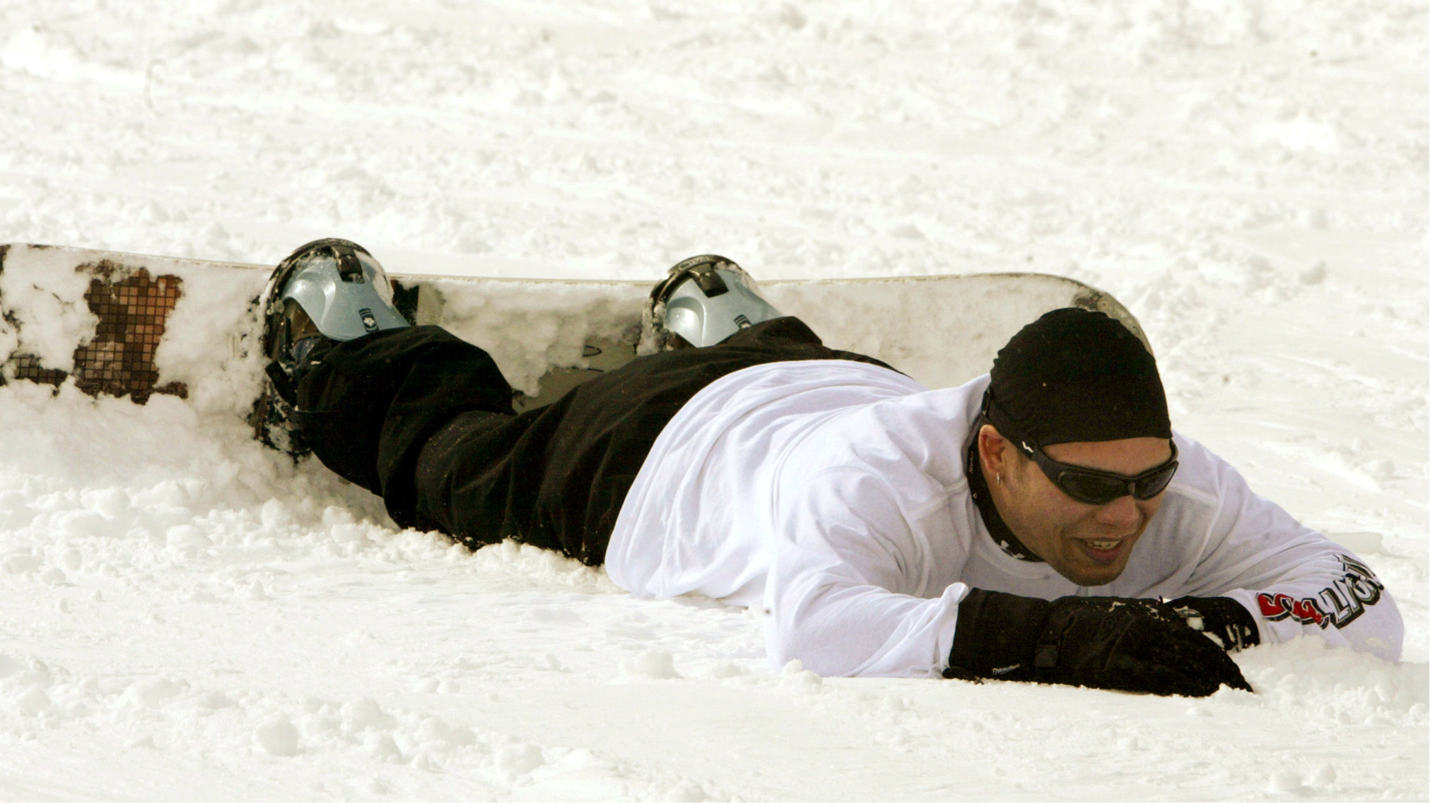 snowboarder face down in snow