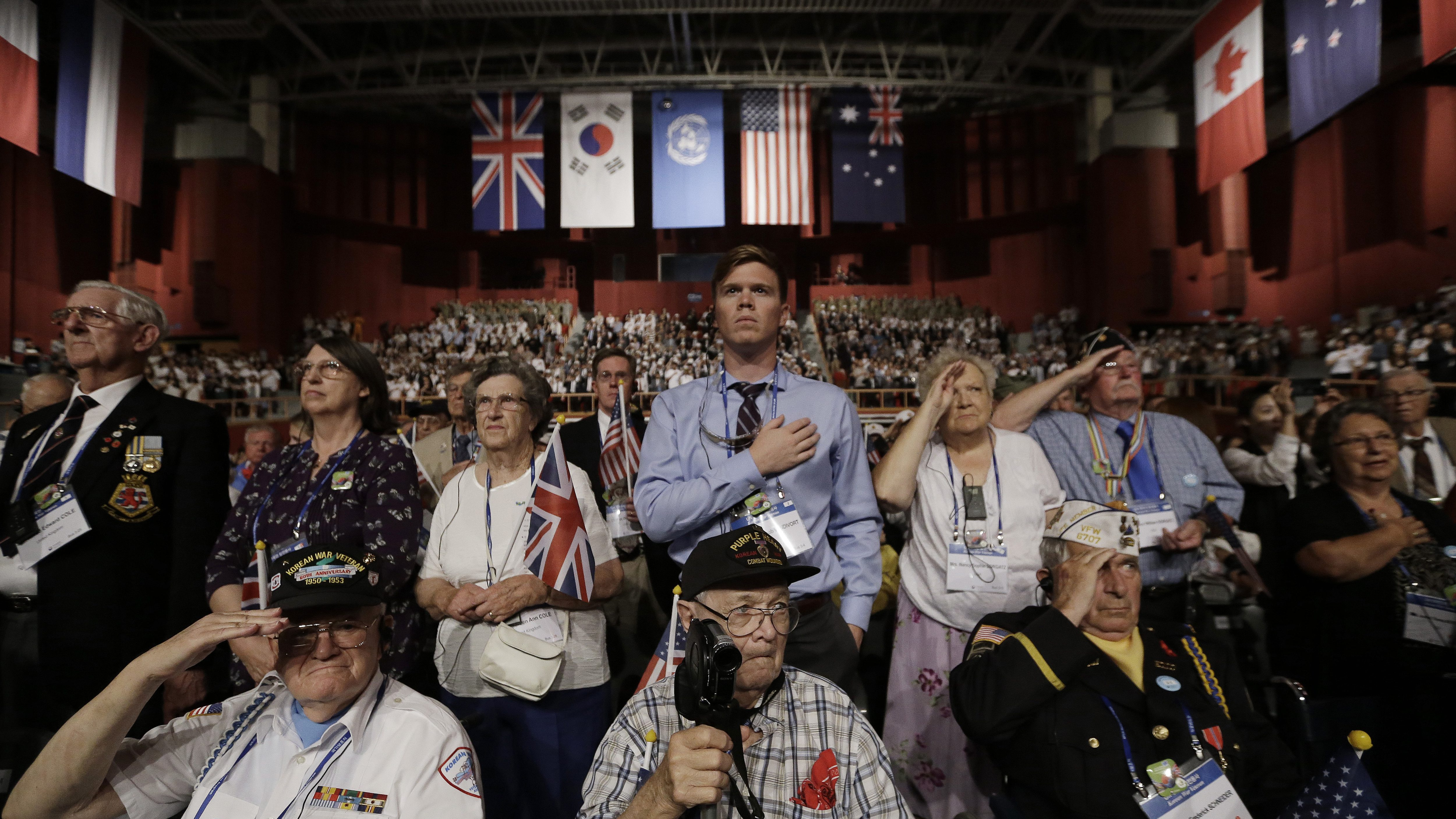 Foreign veterans of the Korean War and their family members salute during a commemorative ceremony marking the 63rd anniversary of the Armistice Agreement and UN Forces Participation in the Korean War in Seoul, South Korea, Wednesday, July 27, 2016. South Korea is accusing rival North Korea of floating propaganda leaflets via a river in the first such incident. (AP Photo/Ahn Young-joon)