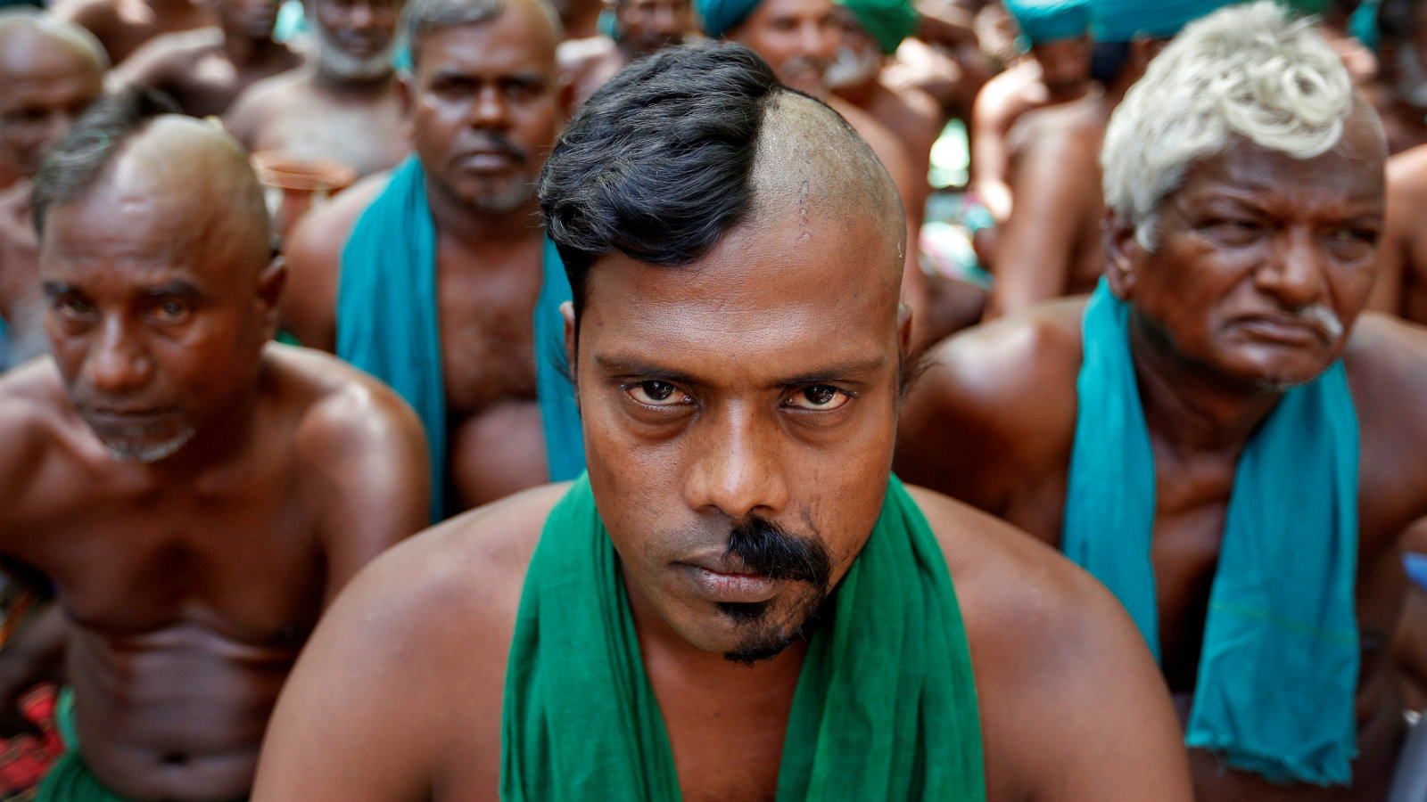 Tamil farmers pose half shaved during a protest demanding a drought-relief package from the Narendra Modi government, in New Delhi.
