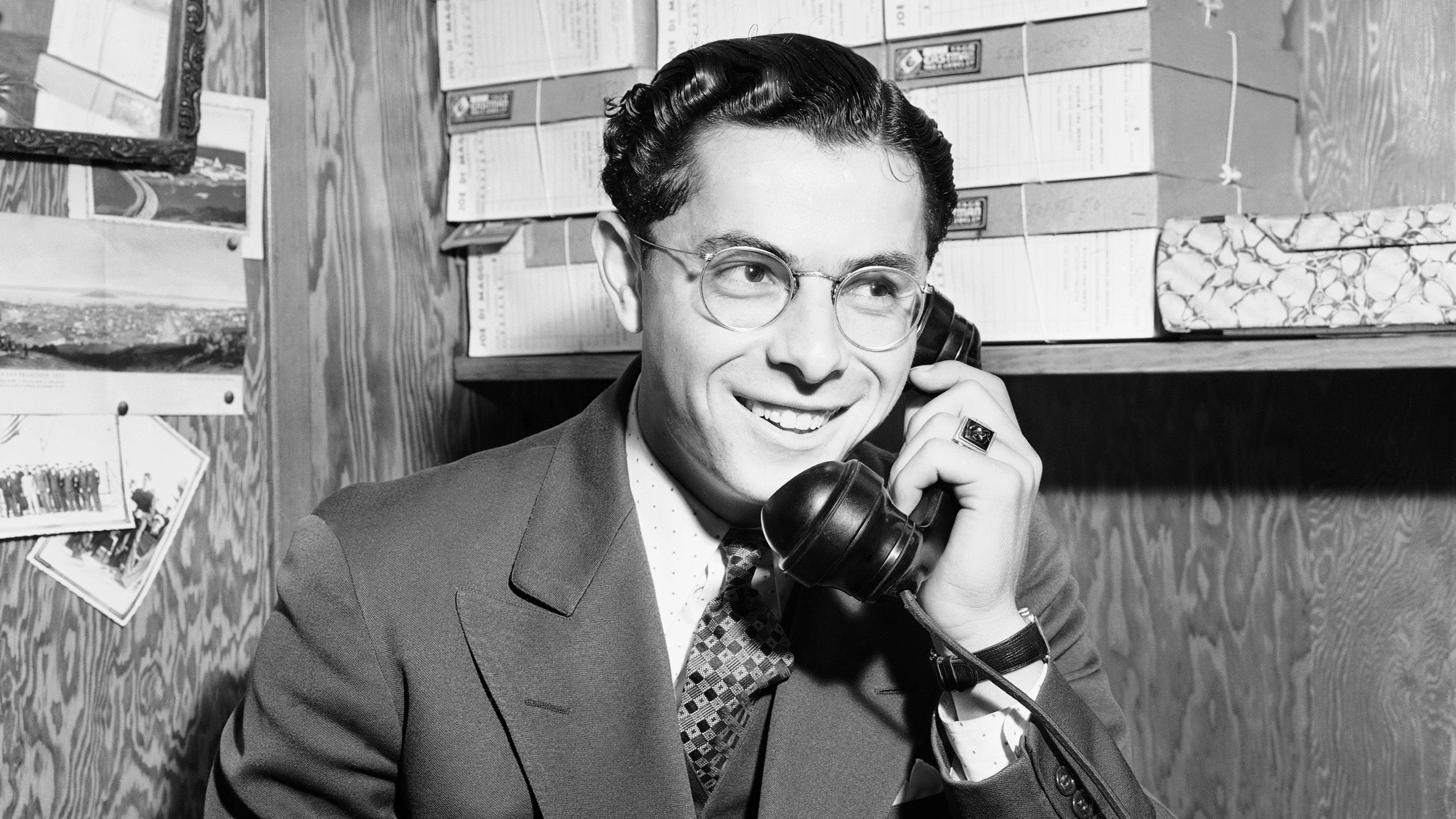 Dominic DiMaggio, youngest brother of the DiMaggio baseball clan, answers one of numerous phone calls afther the news of his sale to the Boston Red Sox got around, Nov. 12, 1939.  The 21-year-old was voted the Most Valuable Player in the Coast League last season. (AP Photo/Joe Rosenthal)