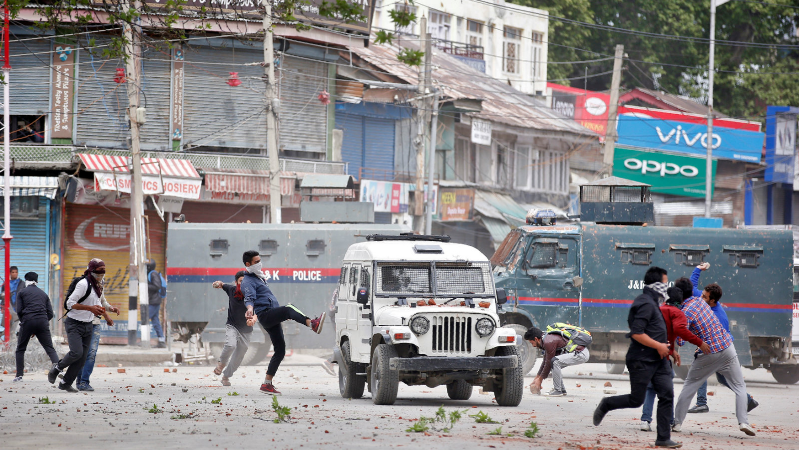 Kashmiri protestors hurl pieces of bricks and stones towards Indian police vehicles during a protest in Srinagar April 24, 2017.