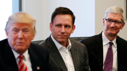 U.S. President-elect Donald Trump speaks as PayPal co-founder and Facebook board member Peter Thiel and Apple Inc CEO Tim Cook look on during a meeting with technology leaders at Trump Tower in New York U.S., December 14, 2016.
