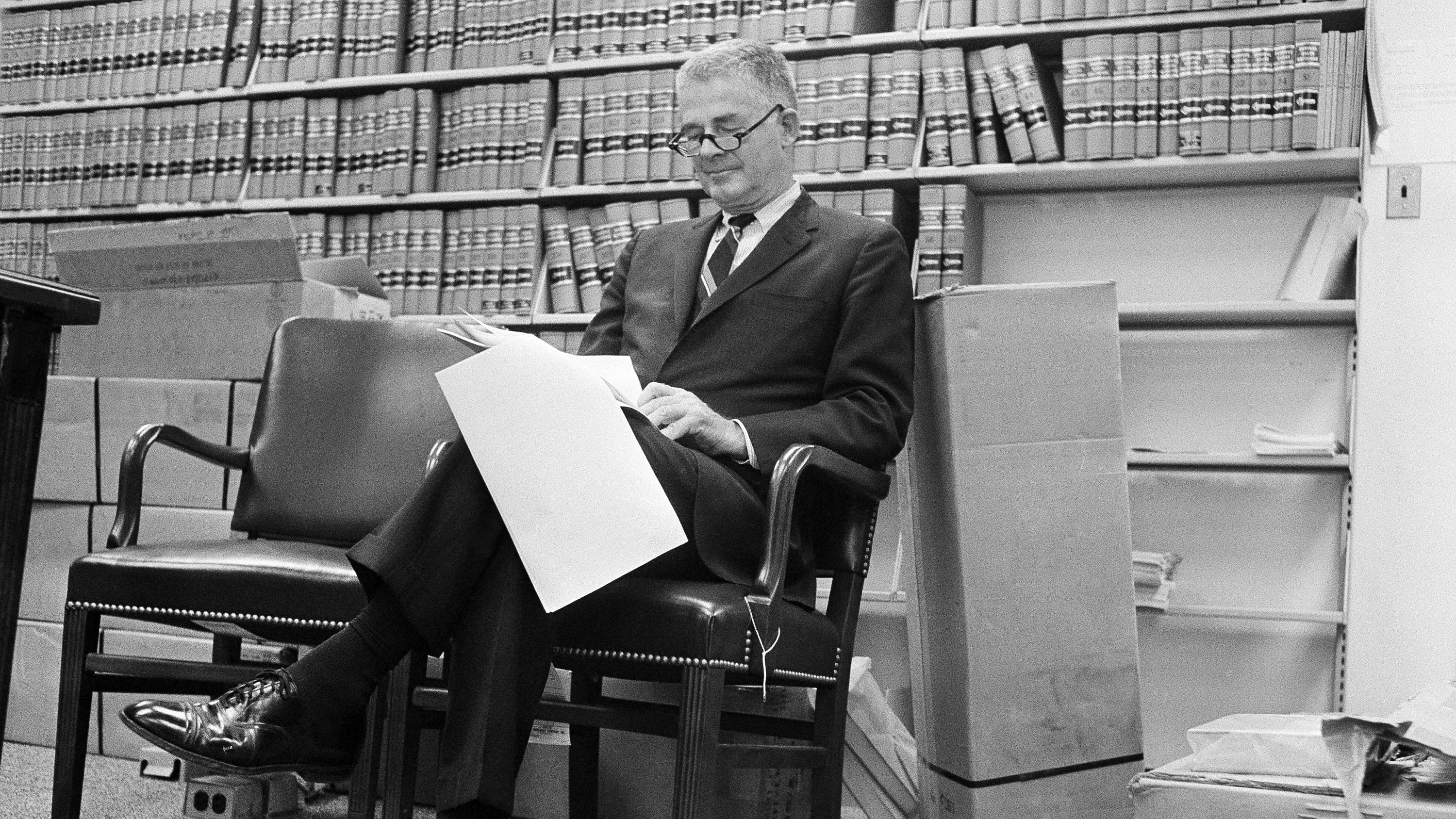 Special Watergate prosecutor Archibald Cox sits in his Washington office as he reads U.S. District Judge John Sirica's order that President Nixon produce tapes of the White House conversations on Watergate for private judicial inspection, Aug. 29, 1973. ()